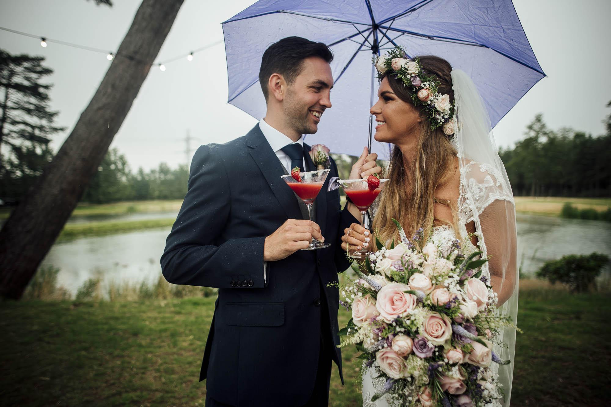 Bride & Groom share a cocktail on their rainy wedding day