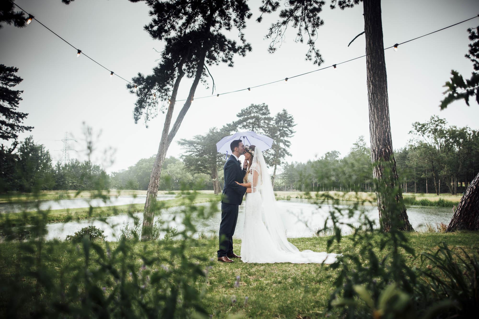 Bride & Groom on a rainy wedding day