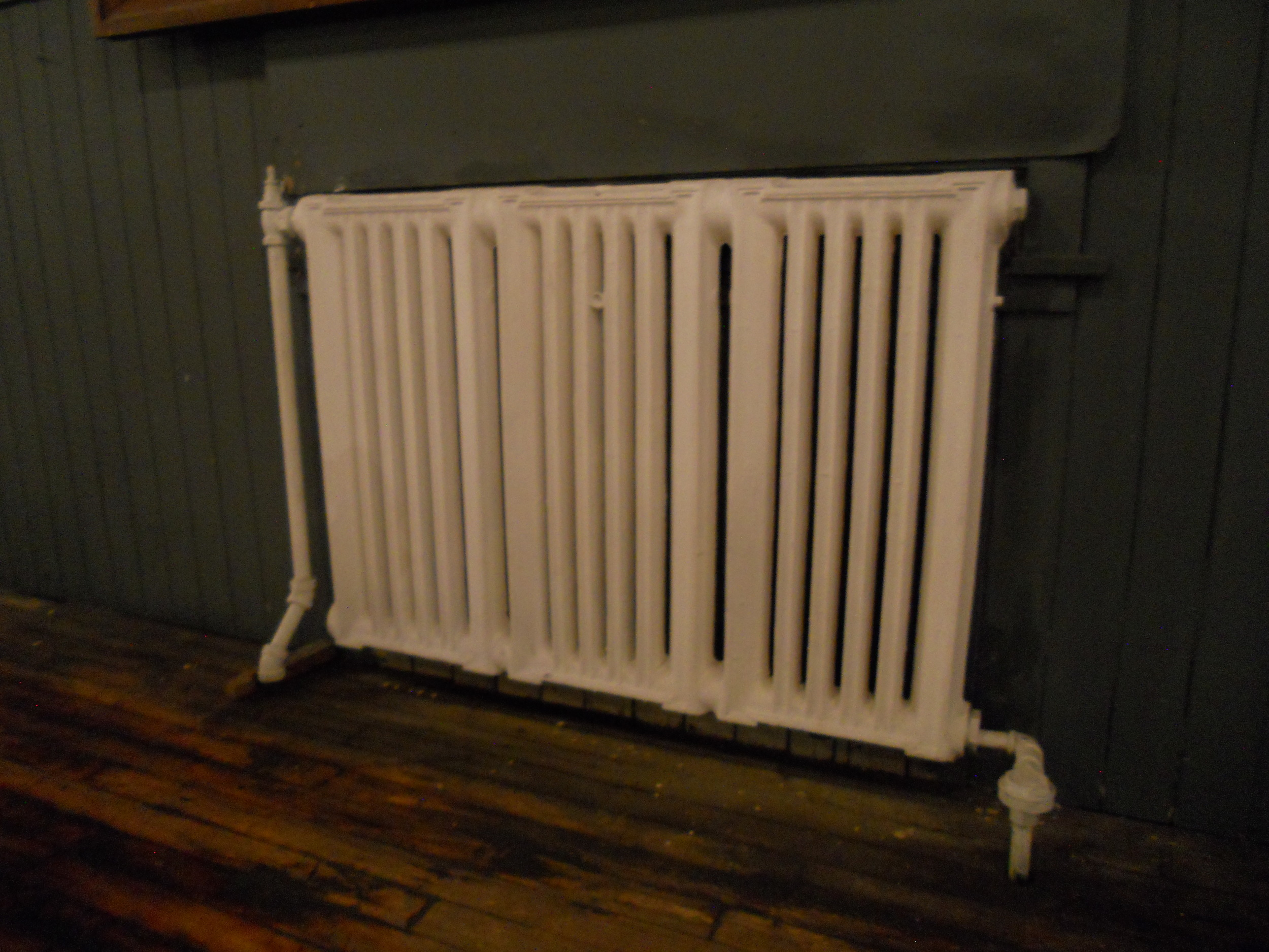 New forced air heating and cooling will eliminate the old radiators.