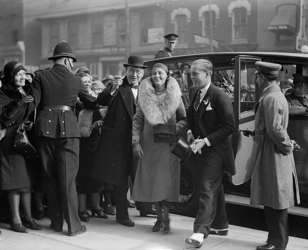Lady Eaton and John David Eaton arriving at Eaton's department store on College Street, Toronto, Ontario, 1930. City of Toronto Archives, fonds 1244 item 1641.