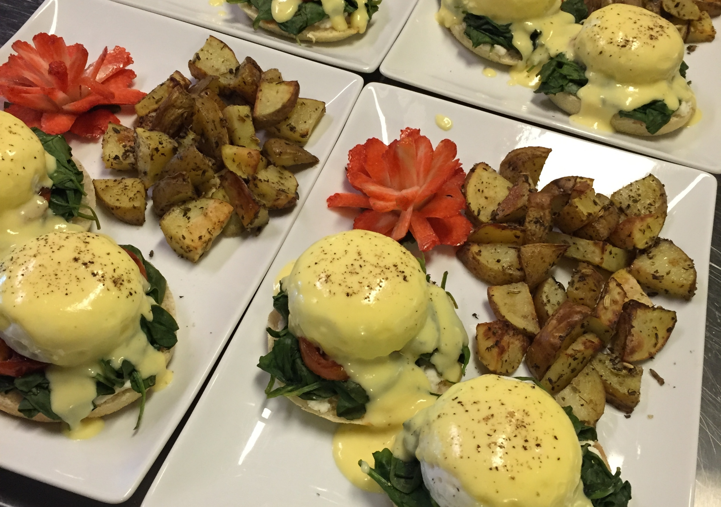 Enjoy a delicious vegetarian breakfast every morning--here you have a traditional Eggs Florentine with roasted potatoes.