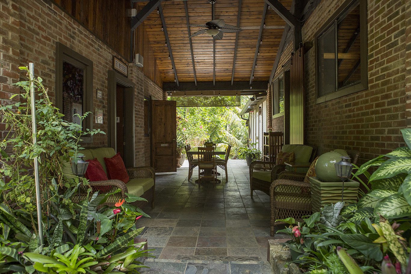 Take your breakfast in this lovely outdoor/indoor room -- The Breezeway.