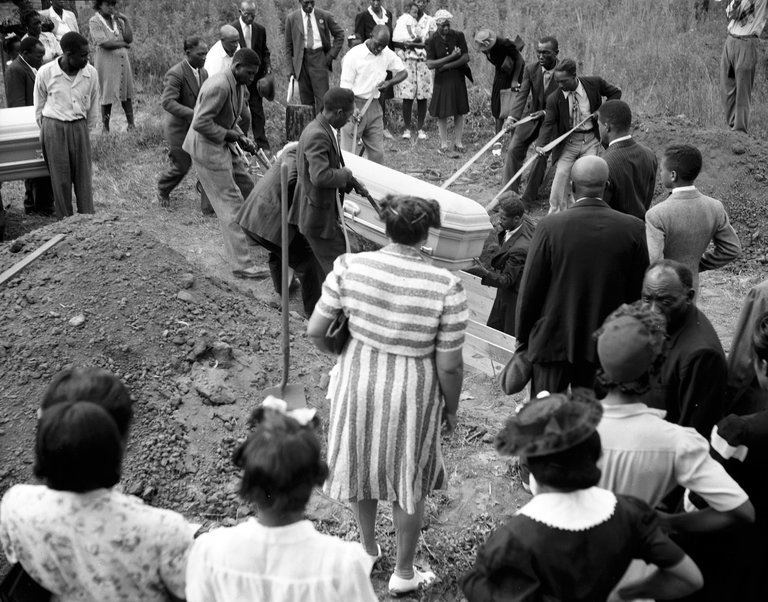 The burial of two lynching victims, George Dorsey and his sister, Dorothy Malcolm, in Bishop, Ga., in 1946.  CreditThe Atlanta Journal-Constitution, via Associated Press