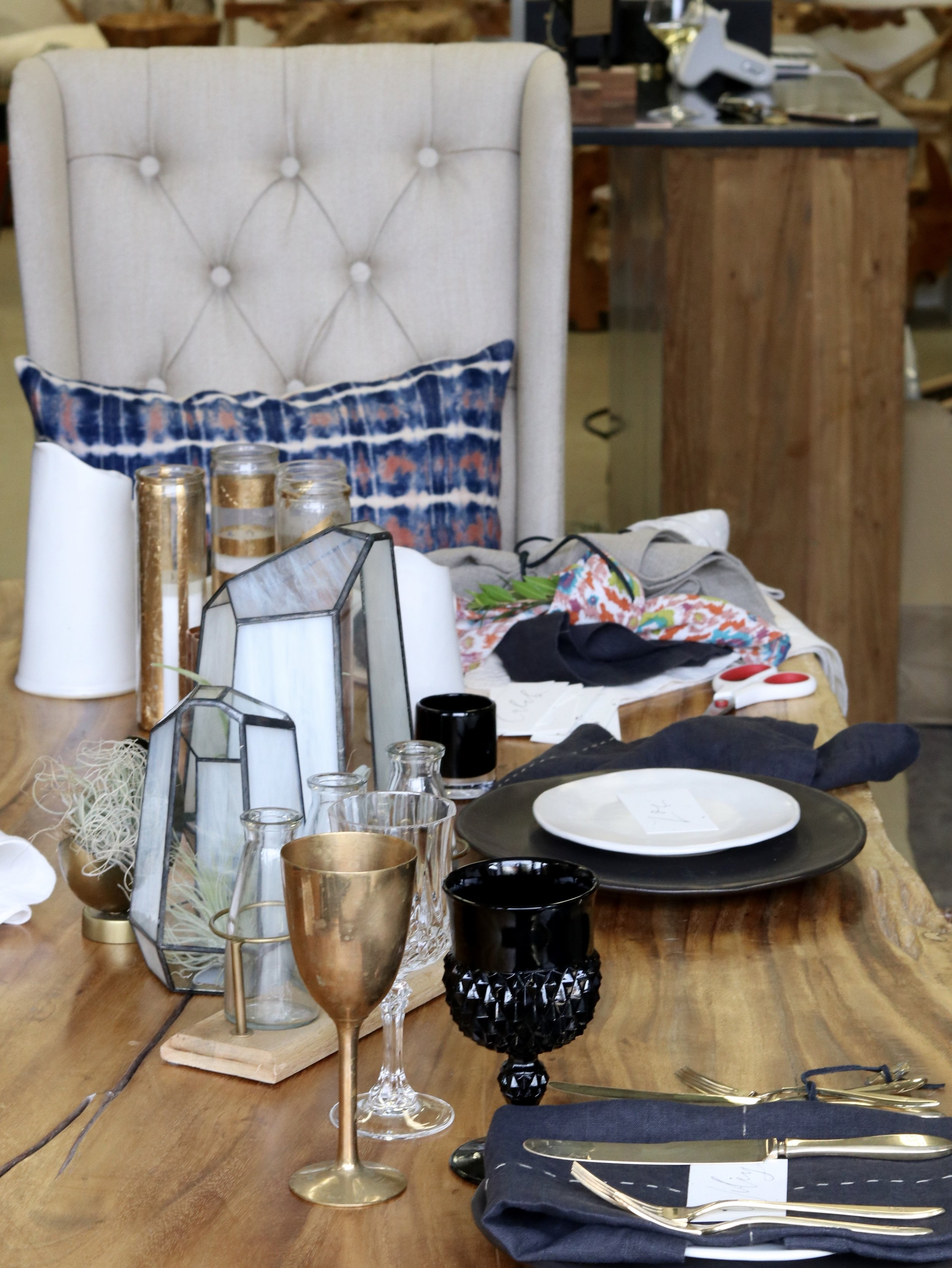 Ceramic plates from South Africa (available at Millworks)  pared with vintage glassware and silverware from Otis & Pearl, and FOLD signature napkins in charcoal linen.