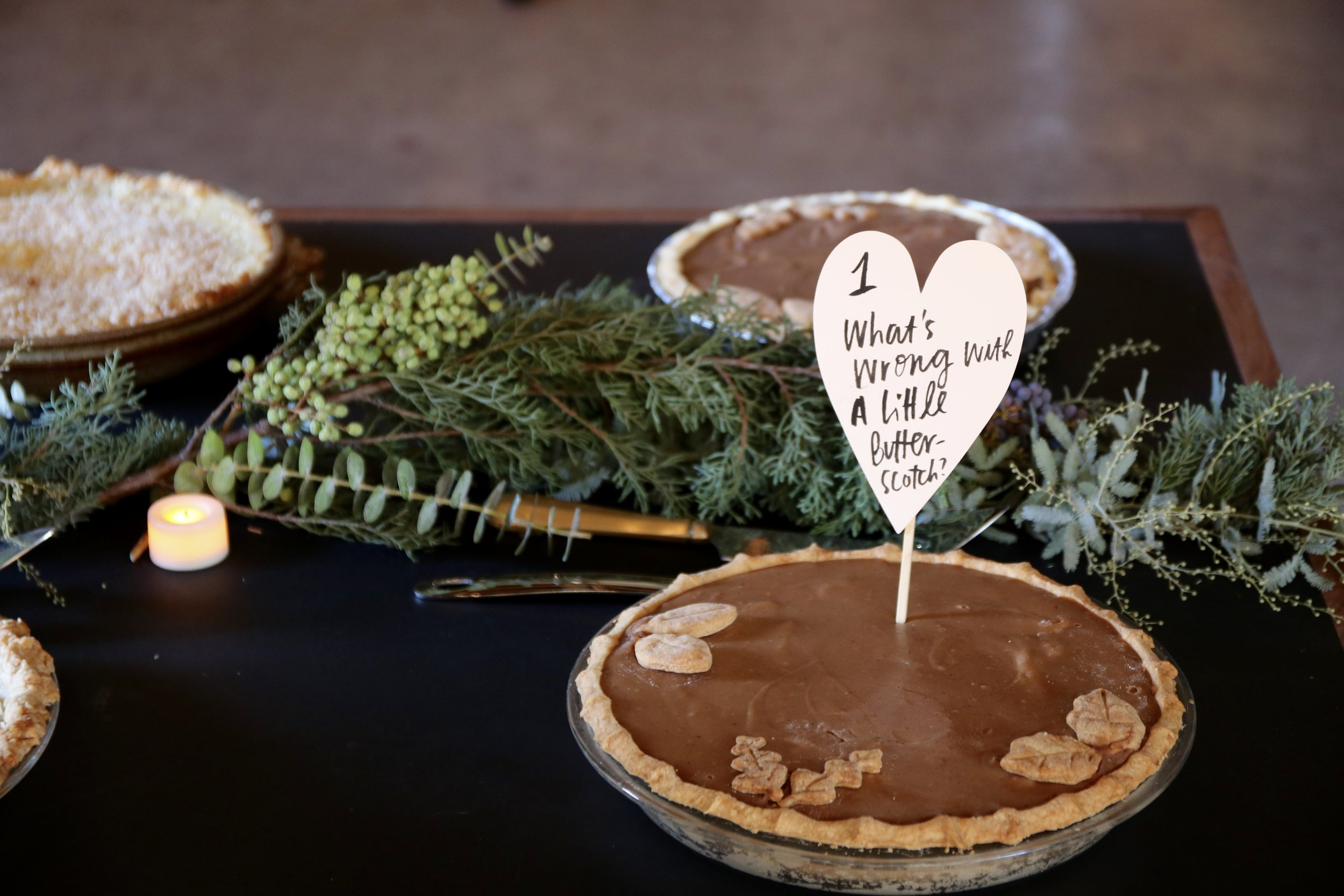 One of the pies in the line-up.  Contestants came up with clever ways to describe and name their creations. Signs by Joya Rose Groves. Foraged seasonal garland by Olivetta Flowers and Foliage.