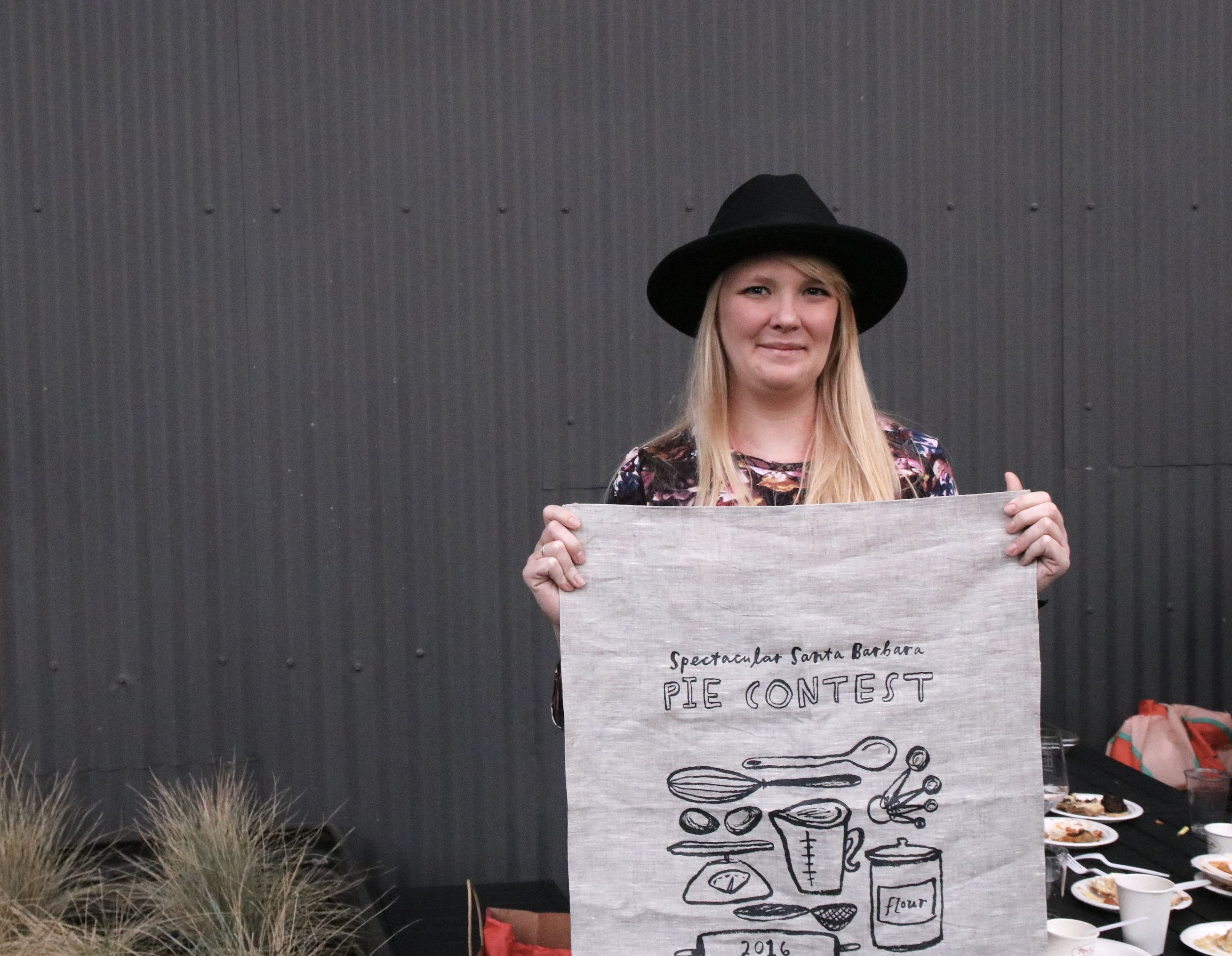 One of the winners proudly receiving my screen printed towel as a prize. Original artwork by Joya Rose Groves.
