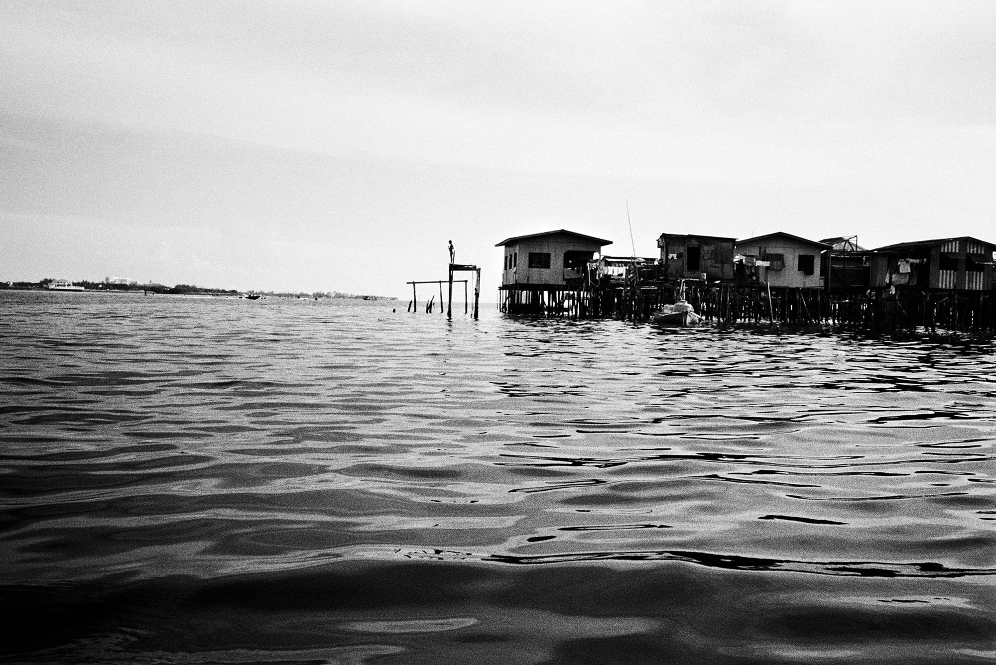 Many stateless children live in Pulau Gaya, where migrants have created a floating slum on the island across the strait from Kota Kinabalu.