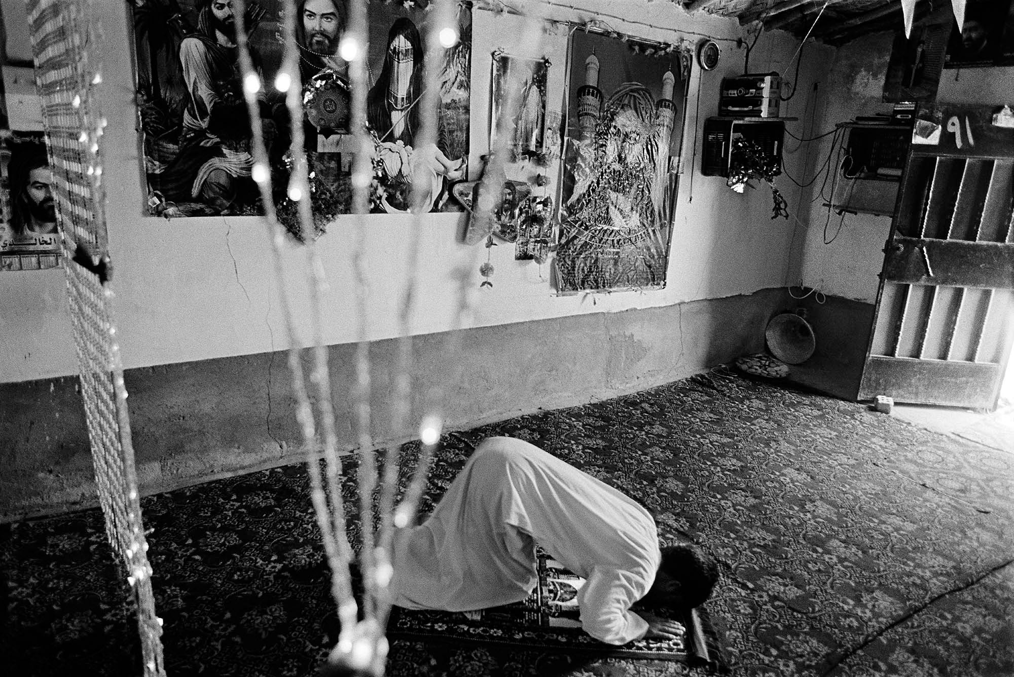 One hundred and twenty Dom families live in the Dom village of Al-Zuhoor, an isolated settlement outside of Diwaniyah. A young man from prays at the community mosque in a Dom settlement outside of Diwaniyah.