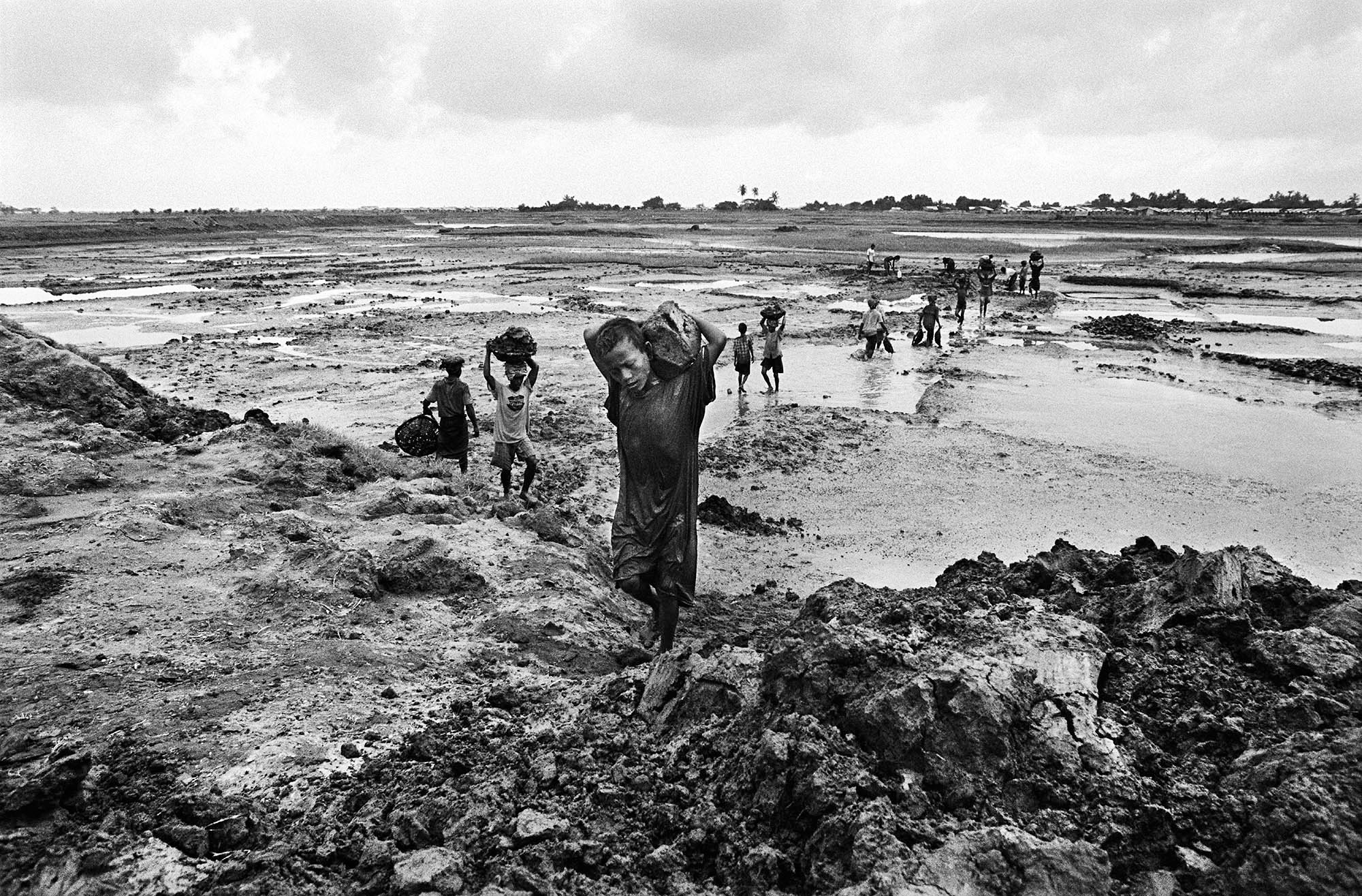 Rohingya in the IDP camps say they feel an entire generation of Rohingya children will not have access to schools and an education. Most children like 7-year-old Nur, who hauls mud at a worksite near one of the IDP camps, have never been to school.