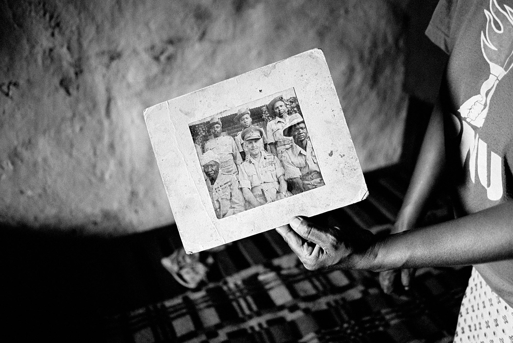 For nearly 50 years following Kenya's independence in 1962, the Nubian community were not formally recognized as a tribe of Kenya and were historically denied recognition. A Nubian woman holds a photograph of her grandfather as an officer in the King's African Rifles.