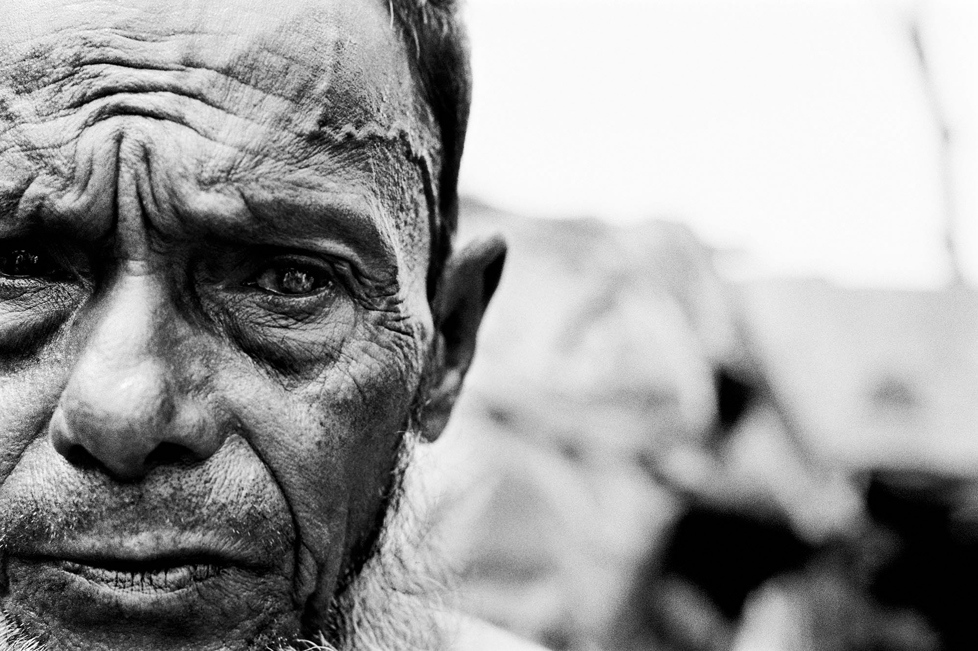 Blind in one eye after being beaten in the head during forced labor, this stateless Rohingya man fled from Burma in the mid 1990's and is one of an estimated 250,000 stateless Rohingya living in the southern part of neighboring Bangladesh.