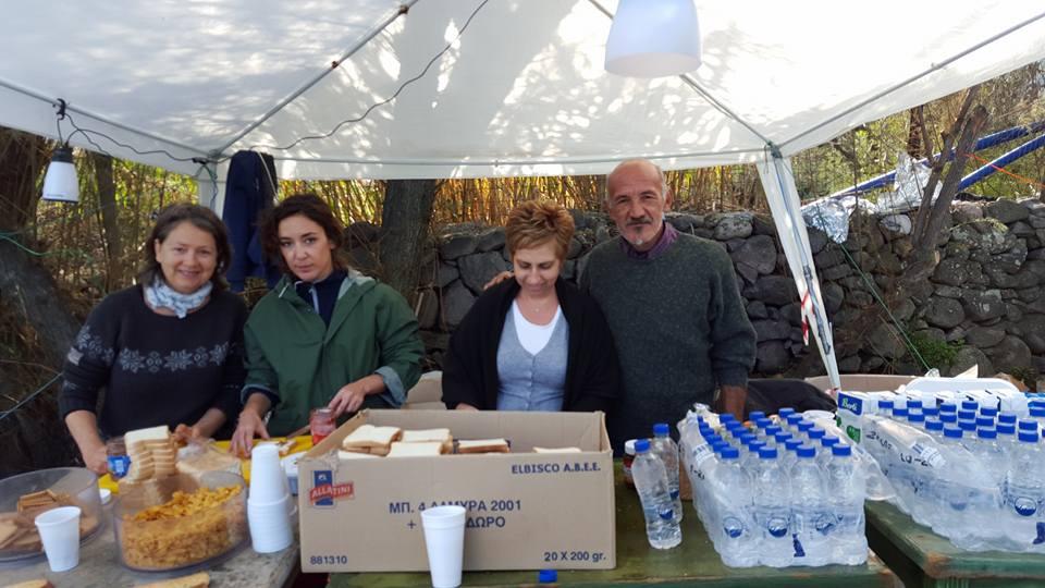 Volunteers at Skala, making sandwiches and distributing food.