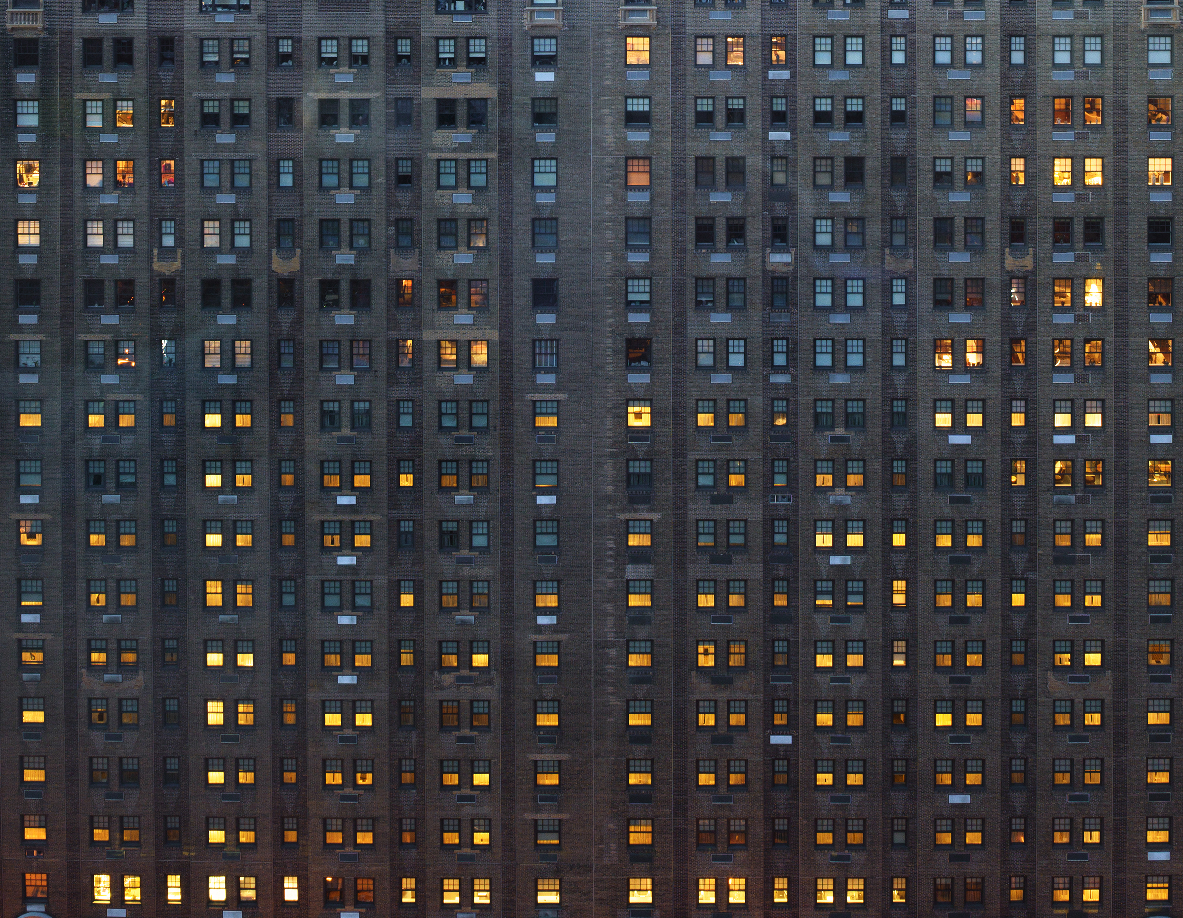 Crop from an image I took last night during a night photo shoot in Philly. It appears to me that the people on the lower floors arrive home first.