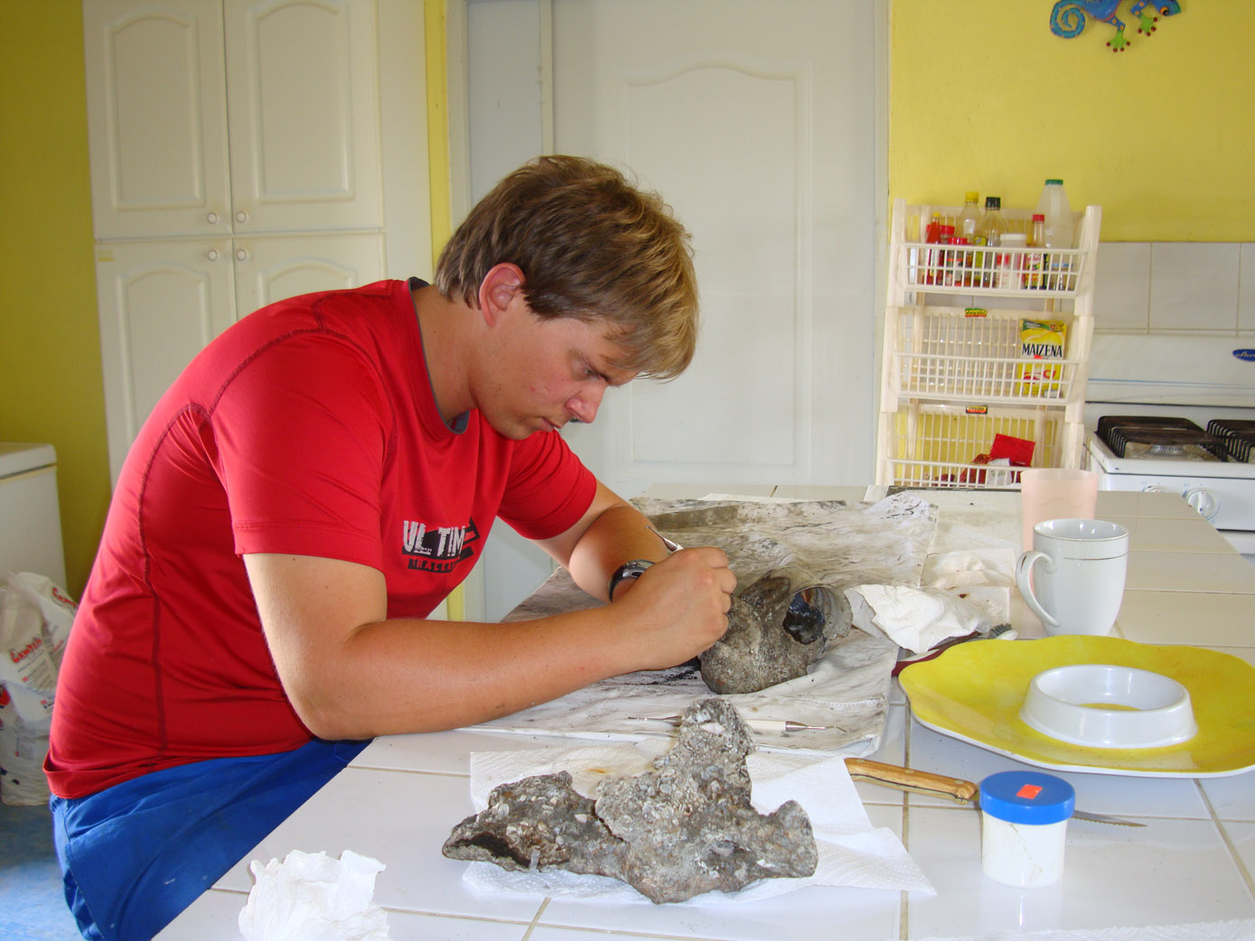 Wesley conserving an iron concretion from the Tile Wreck