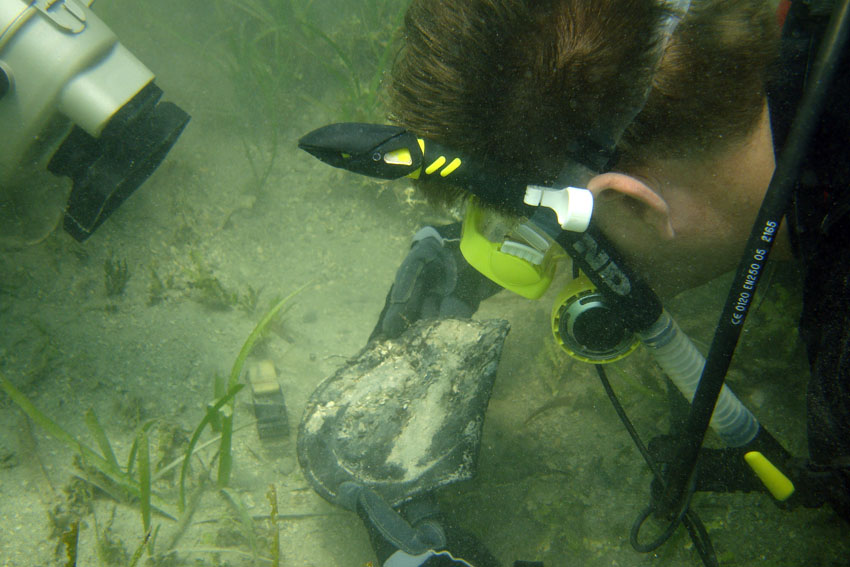 Dr. Spooner uncovering a pewter plate on The Tile Wreck