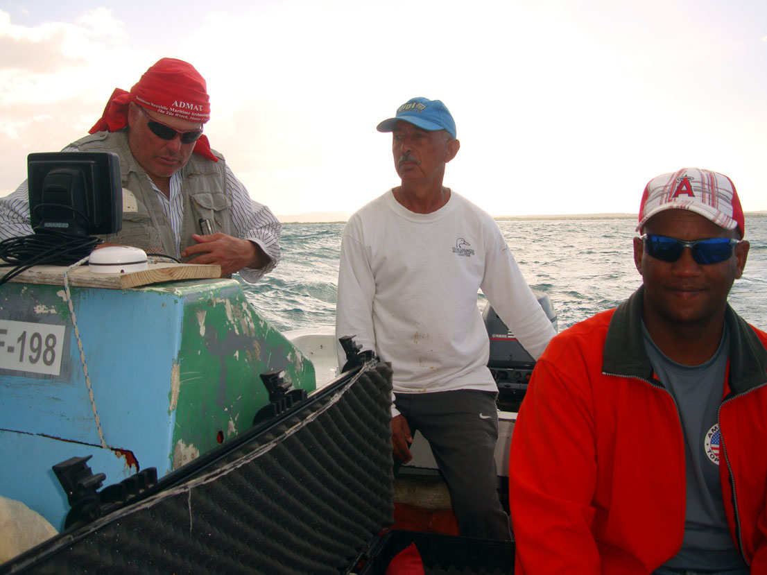 Raimund Krob leads the survey team in Monte Cristi Bay which found the wreck site, with the Captain of Medio Ambiente scientific ship helming the small yola and Sandy from ONPCS.