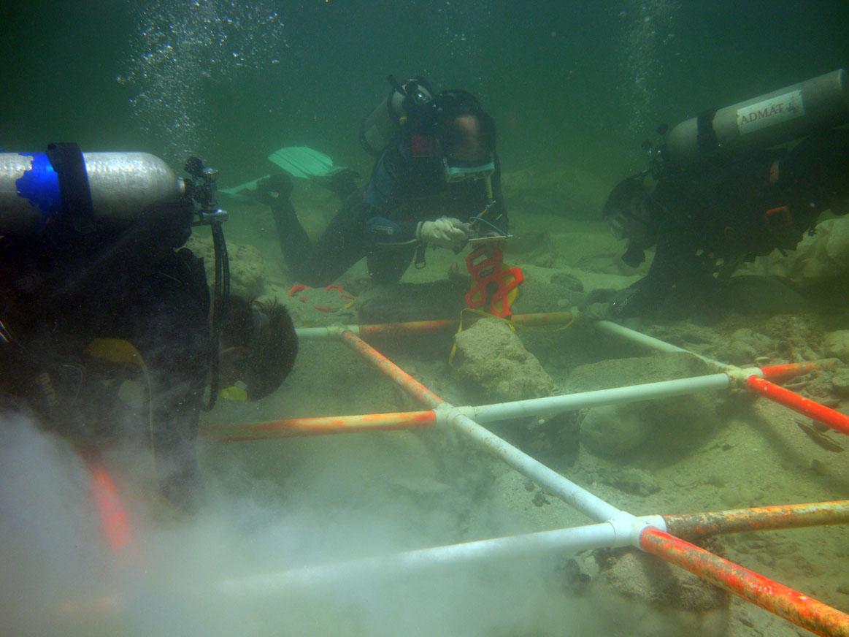Maritime archaeologist Matts measuring