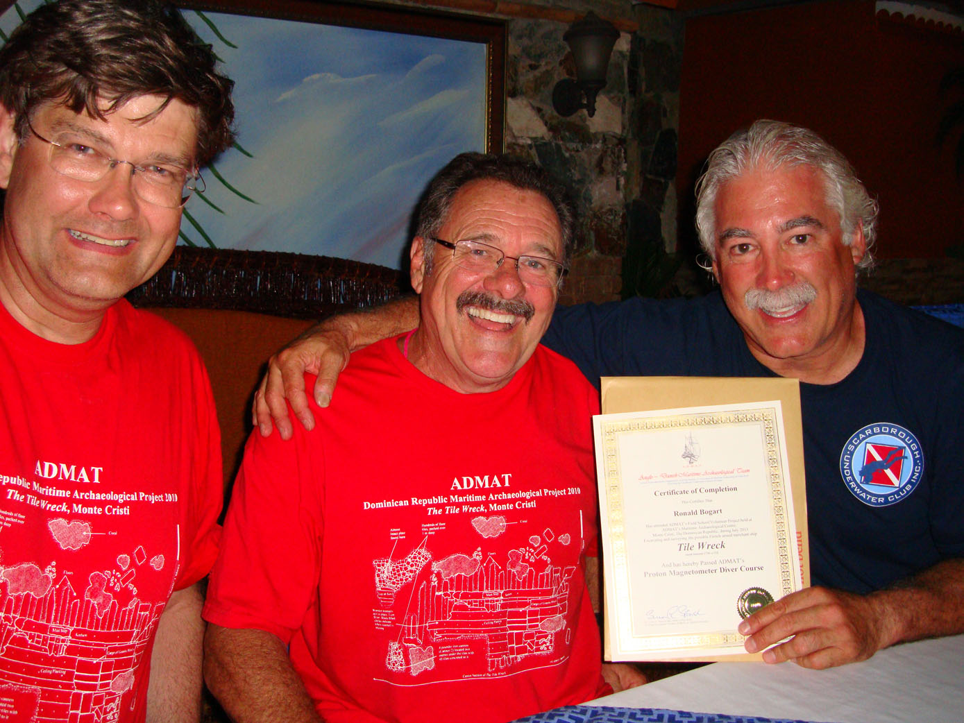 John Downing awarding student Ron his Proton Magnetometer Diver Course certificate, as Ast. Project Leader in 2013, for Ron's work on   The Tile Wreck   where numerous fully armed iron grenades were found