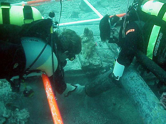 Dr. Spooner leading the excavation below the keel where the remains of a barrel of silver coins were found