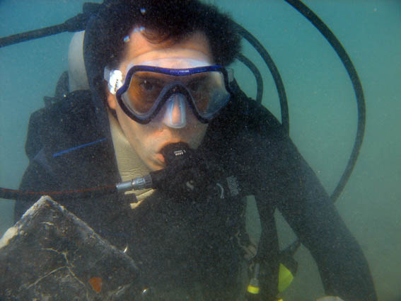 Dr.François Gendron holding a Terracotta Floor Tile on the    Tile Wreck   (Sunk between 1720-1723), in Monte Cristi, Dominican Republic