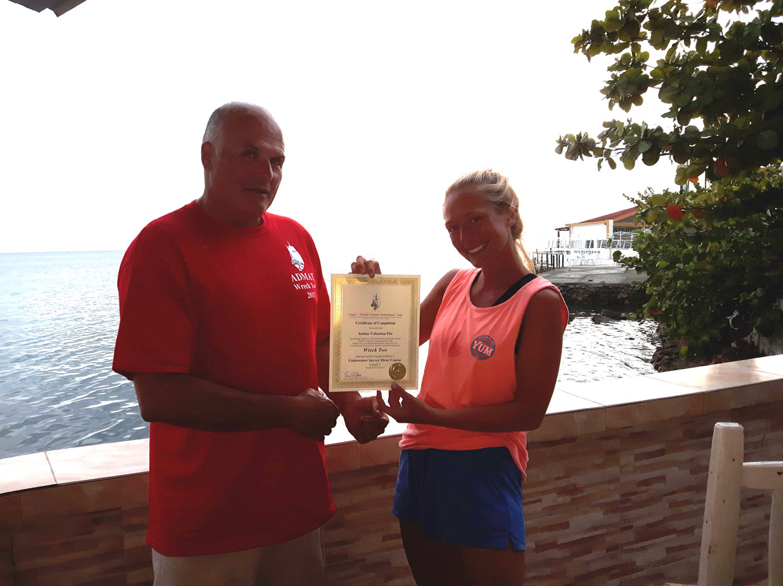 Project Leader Raimund Krob in 2017 presenting Justine Fite with her ADMAT's Underwater Survey Diver Course a PADI SDC certification