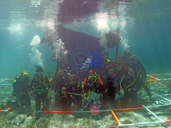 The ADMAT Team flying the Royal Automobile Club Flag on the wreck site