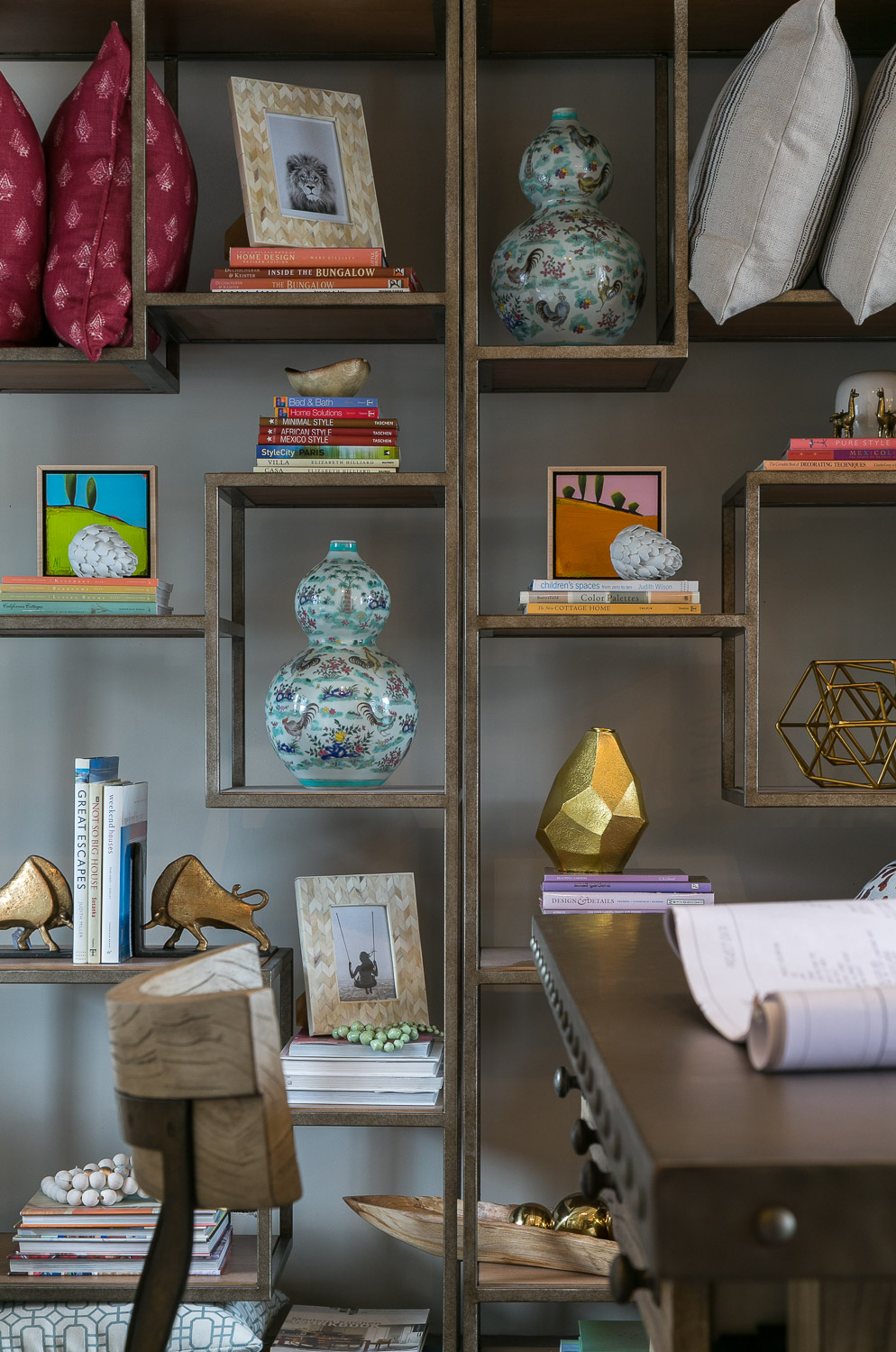 Interior Design by Price Style and Design. Photography by Kathryn MacDonald   Bookcase  //  Picture Frames  //  Gourd Vase  //  Bisoni Bookends  //  Geo Vase  //  Teak Bowl