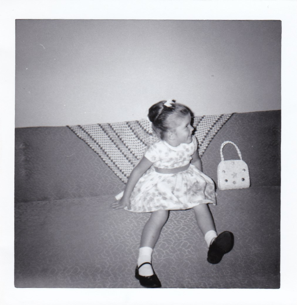 Me circa '64 or '65 in my Sears Catalog dress, bag, shoes, socks and bow!