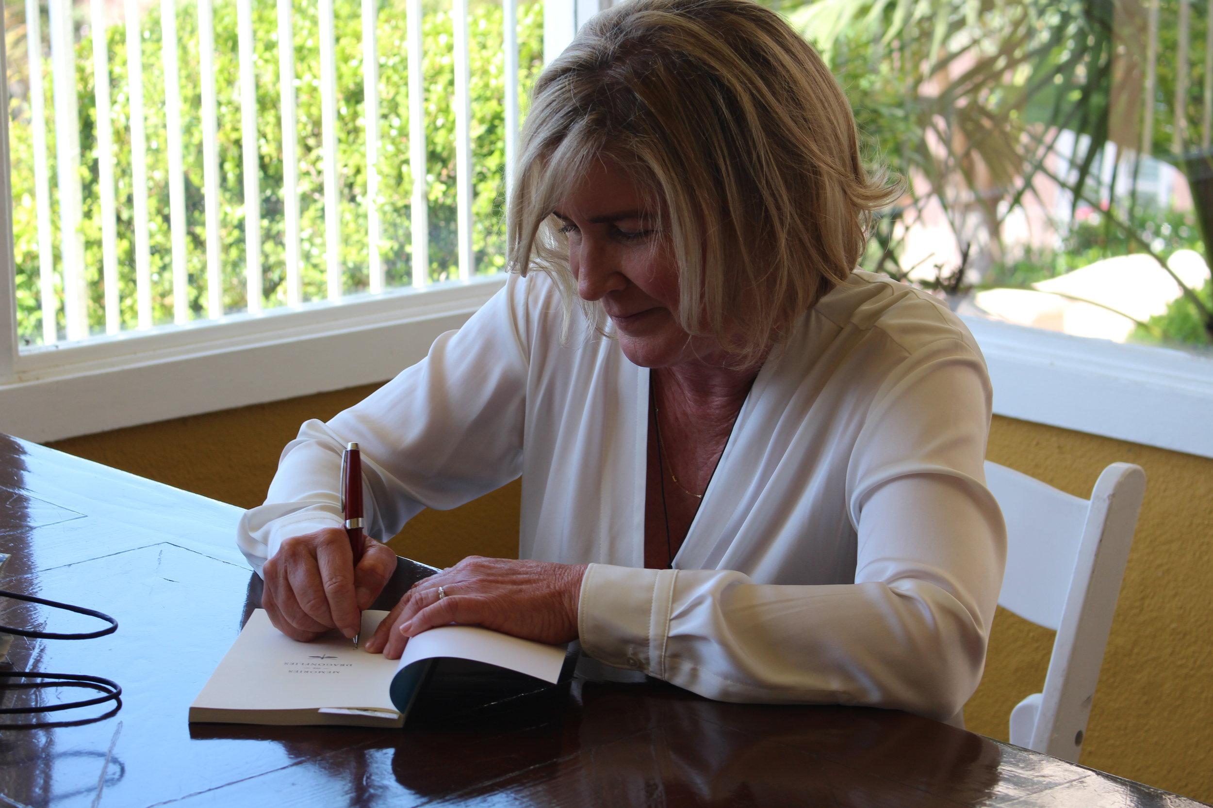 Signing copies.