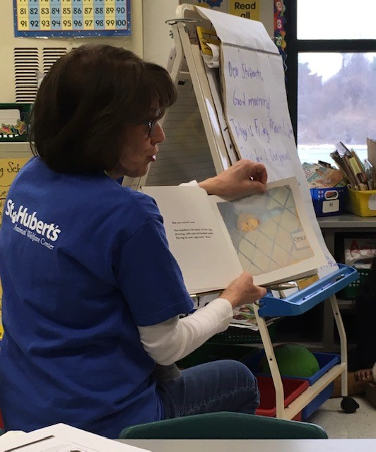 Humane Education volunteer engaging students in a read aloud about animal welfare.
