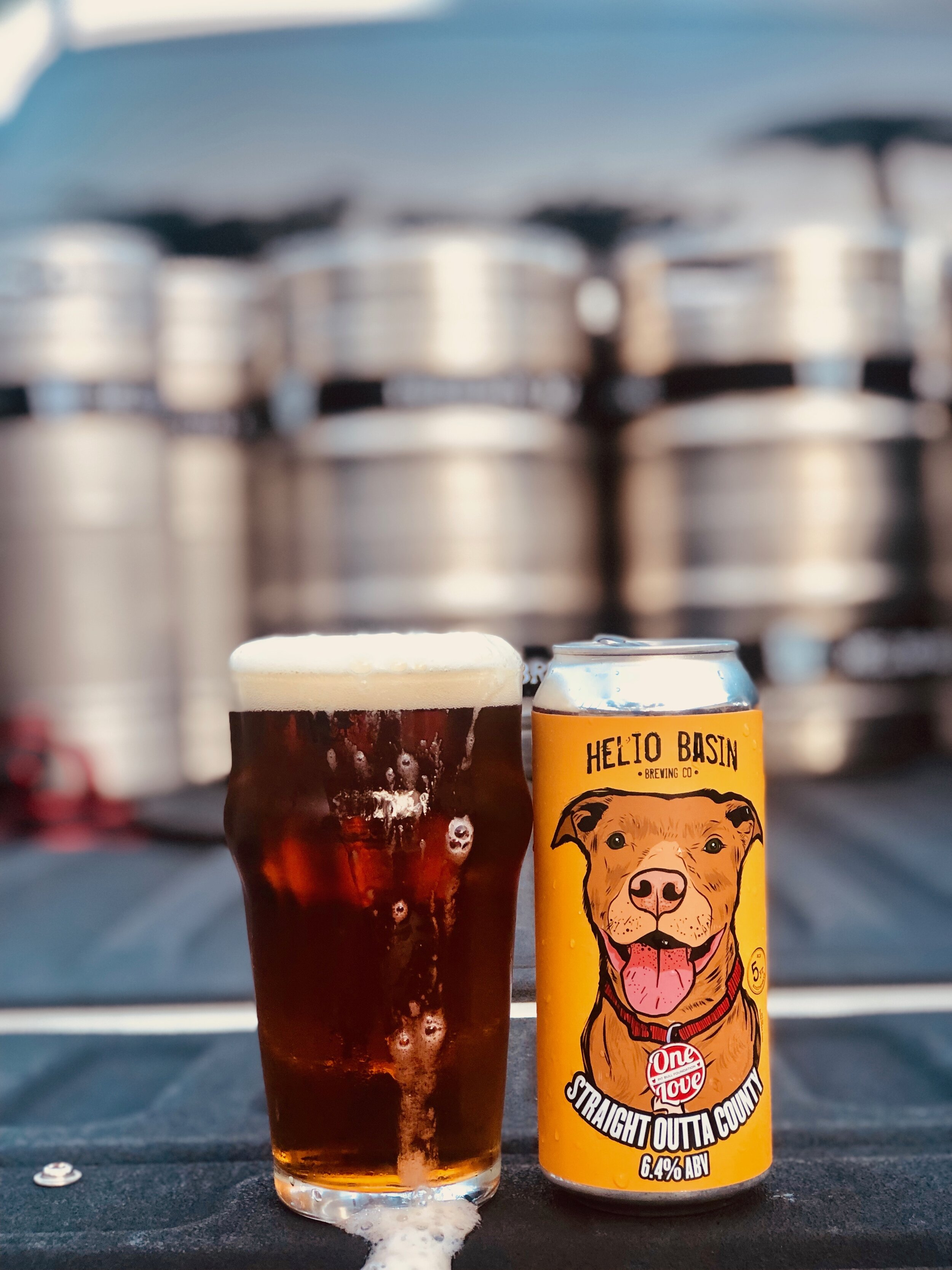 """Straight Outta County - This beer was brewed in collaboration with One Love Pit Bull Foundation, which is a non-profit organization that is dedicated to helping Maricopa County shelter dogs through enrichment and adoption programs. They also focus on pet retention, community outreach and spay/neuter. After meeting with members of their team, it made sense for this beer to be a """"mutt"""" by style. It might not fit in any specific category technically, it's a little bit malty, a little bit hoppy… but like the dogs it represents, it is overall just easy to drink and ready to be loved.Dark copper in color and brewed with Cascade and Amarillo hops. The aroma is subtle with hints of fresh grapefruit. The flavor is a perfect balance of a slight caramel and fresh citrus. This is an easy drinking brew just begging you to take it home!6.4% ABV 40 IBU 