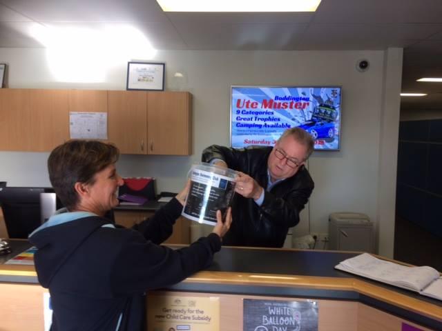 Chris Littlemore, CEO of Boddington Shire Council drawing the lucky winner.