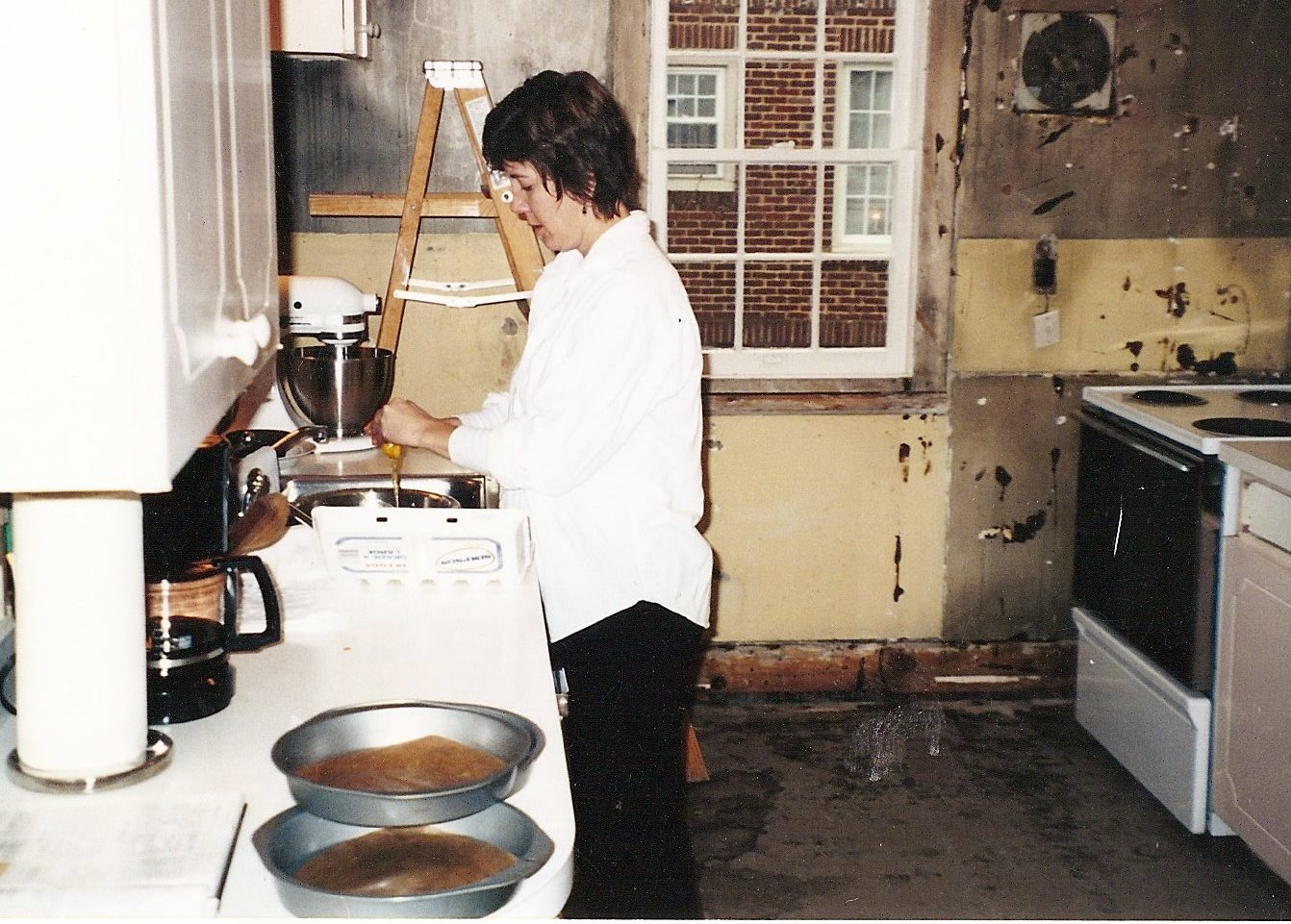 Where it all began! Robin, baking at home amongst a kitchen remodel! Circa 2001.