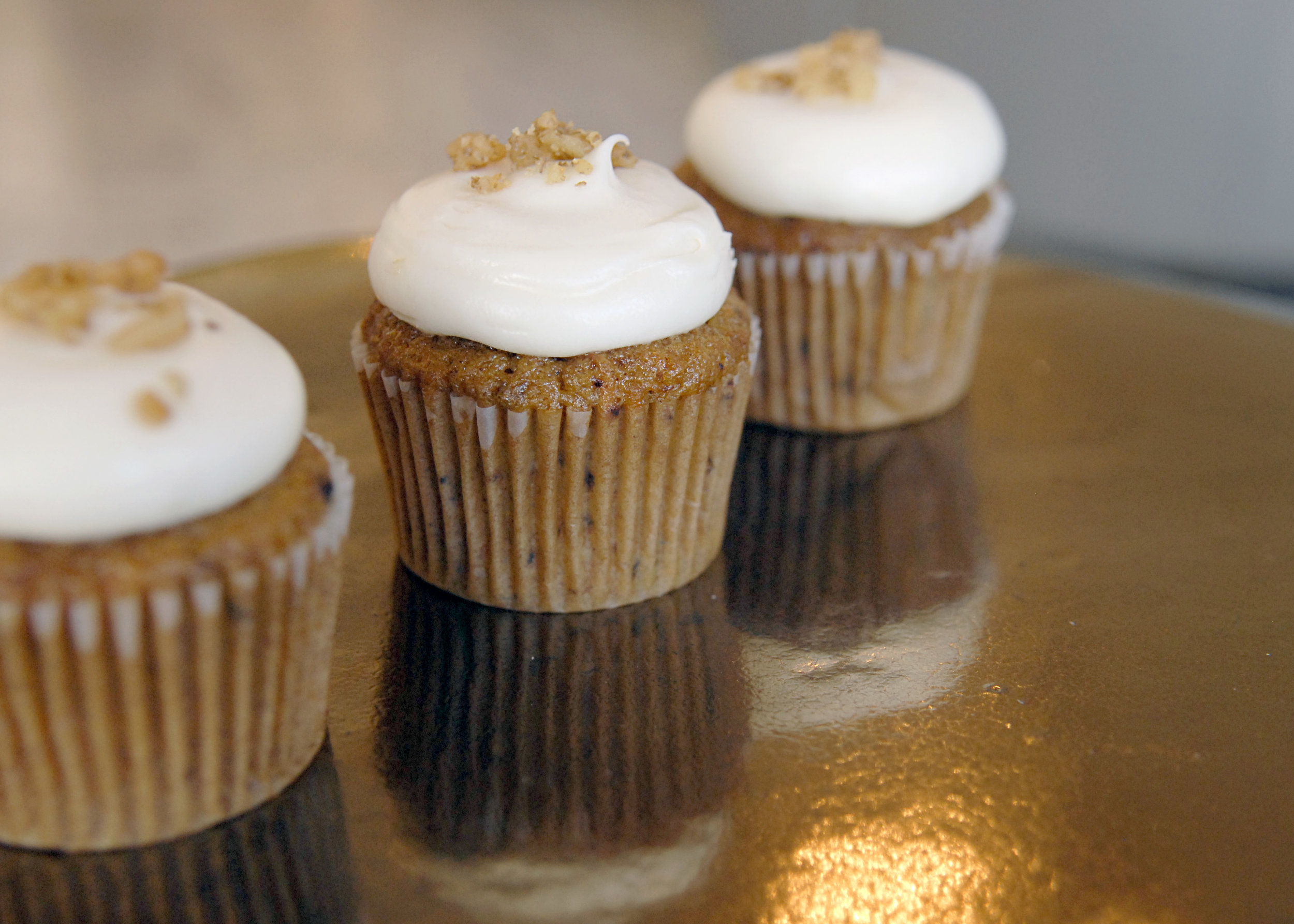 """18 Carat"" Cupcake   2.95 each  Made with grated organic carrots, pineapple, walnuts & spice. Our favorite carrot cake ... ever!"