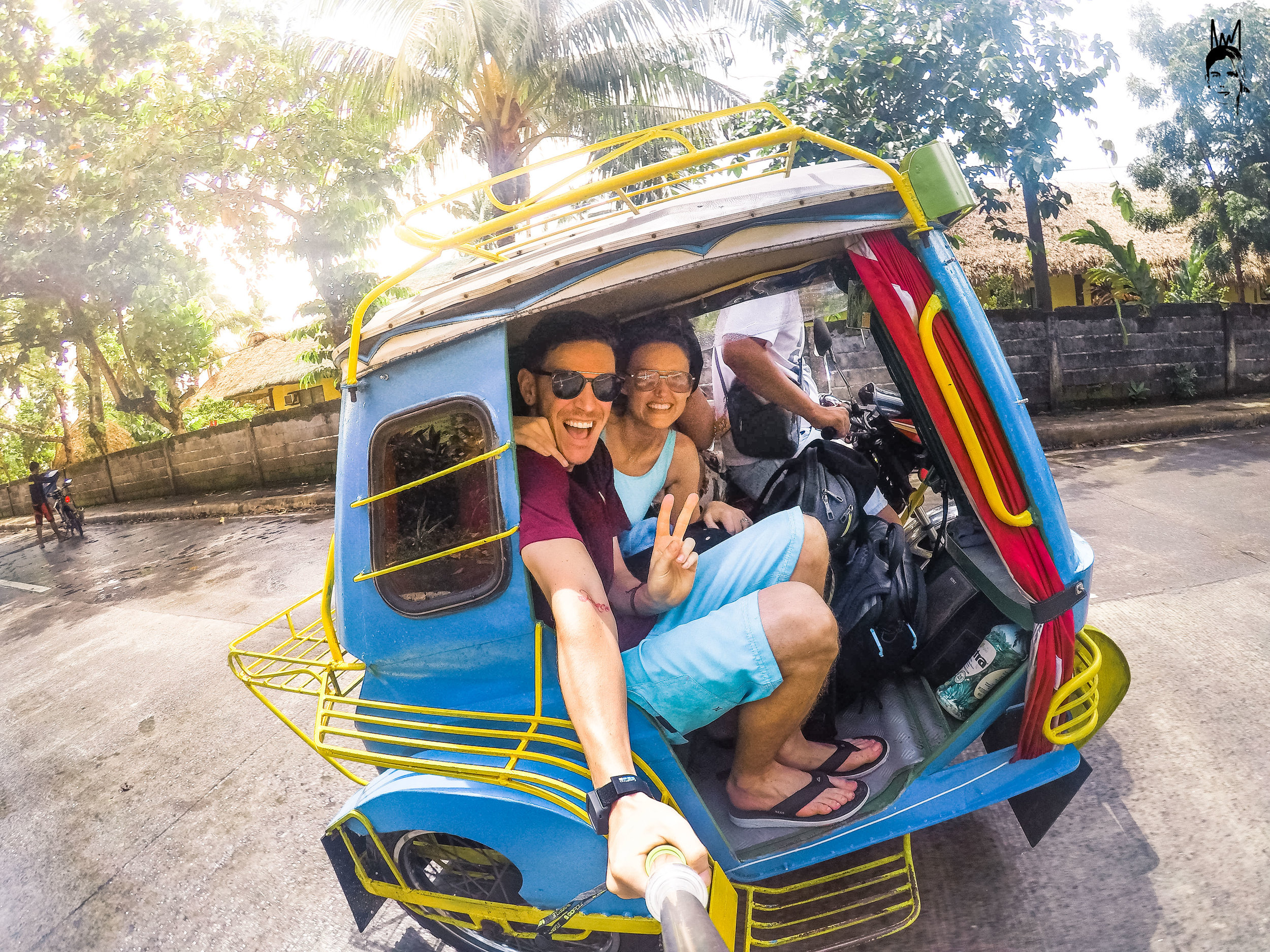 Riding a Tricycle to book our Whale Shark Diving!