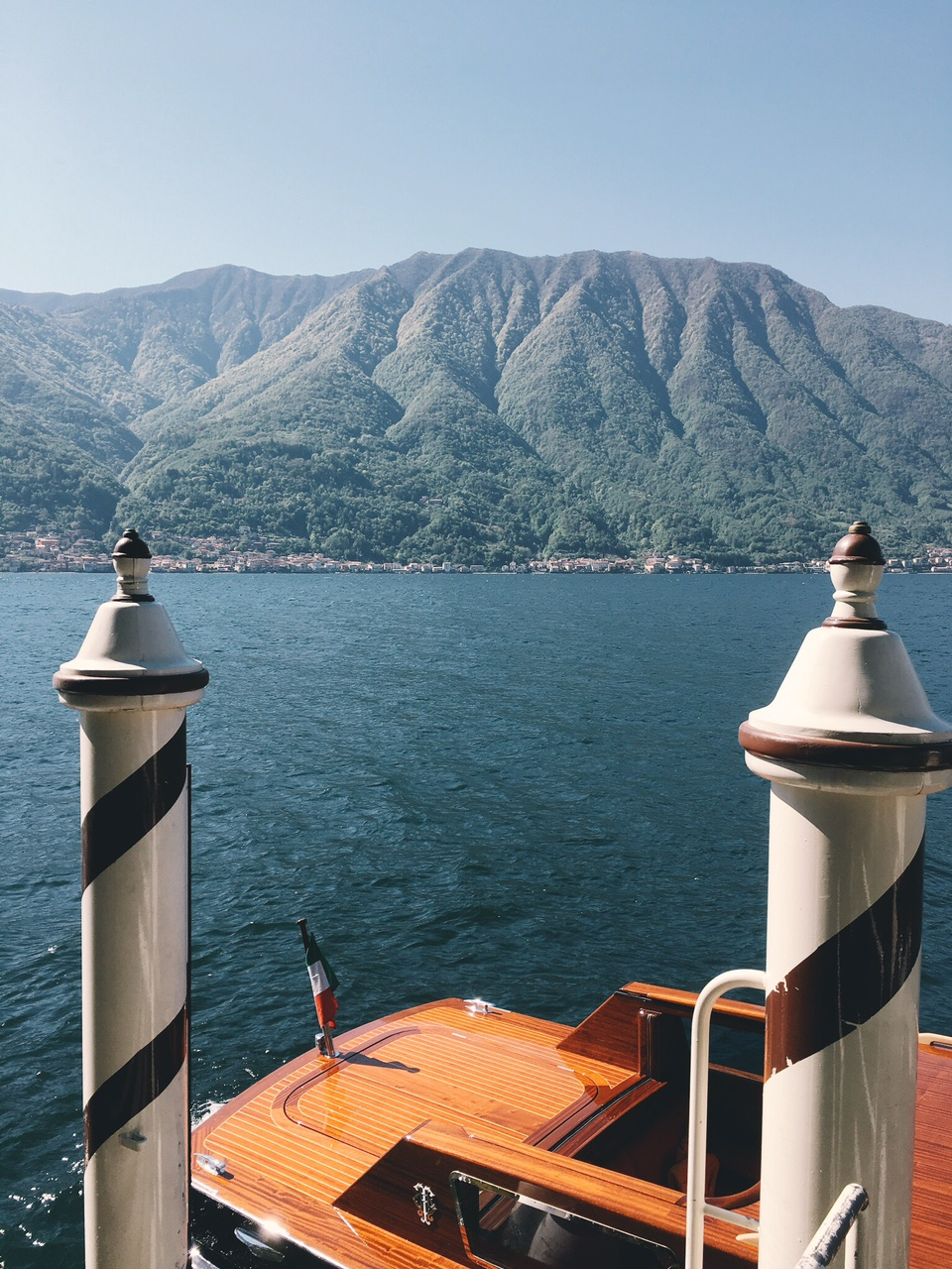 Lake Como view with dock and boat from Villa Balbianello