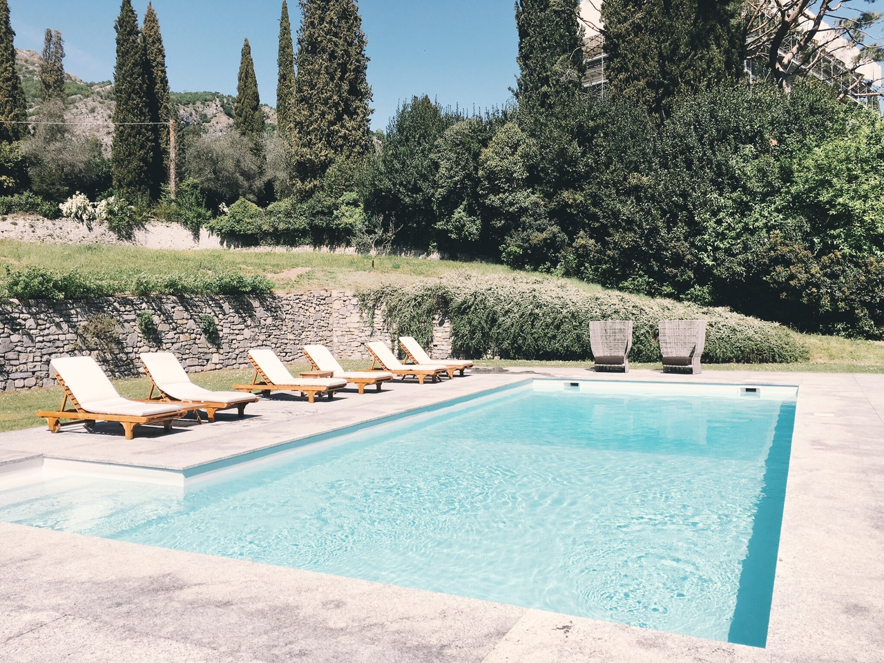 Pool with lounge chairs at Villa Sola Cabiati