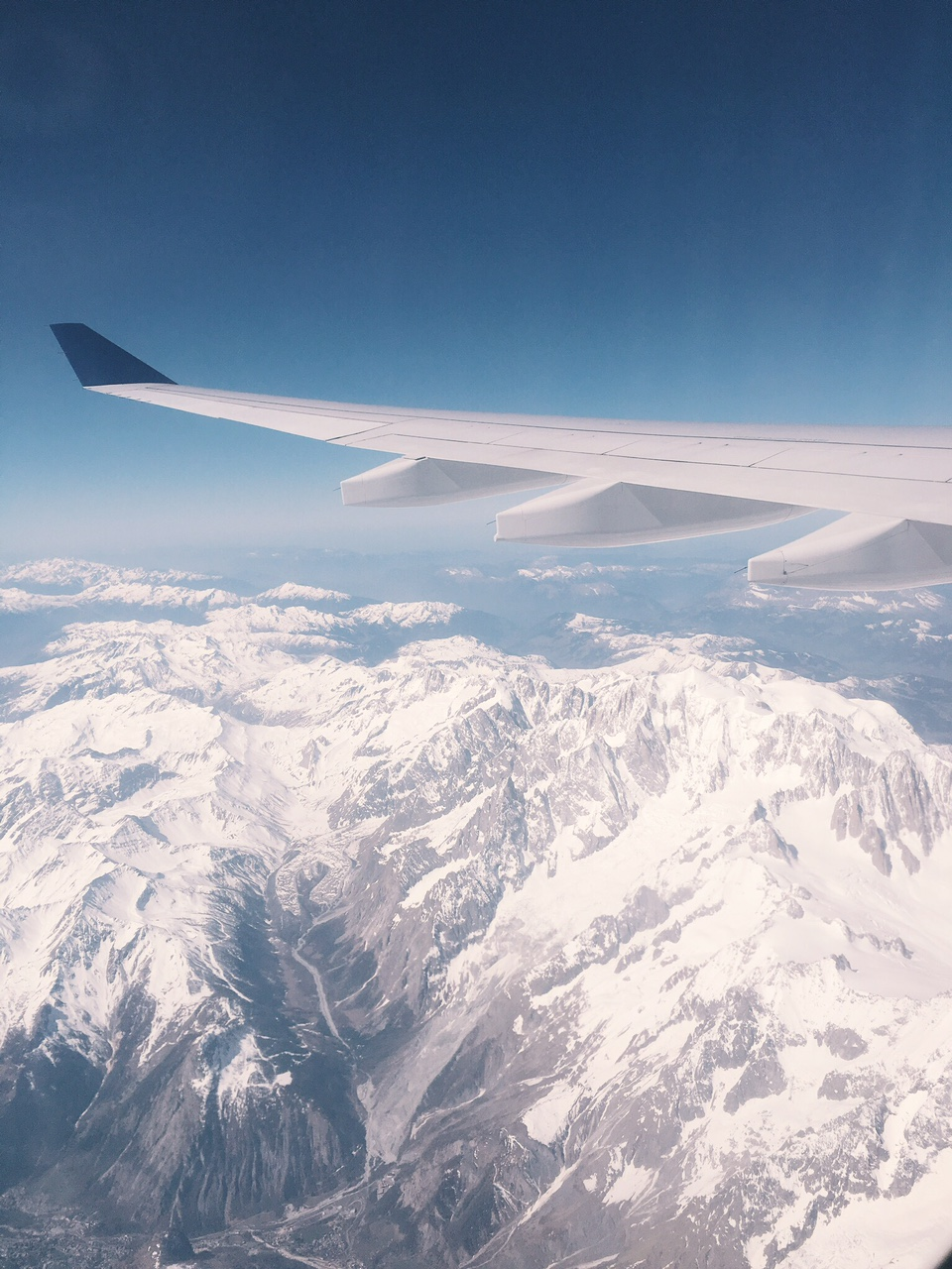 View of Swiss Alps from plane flying from Milan to New York