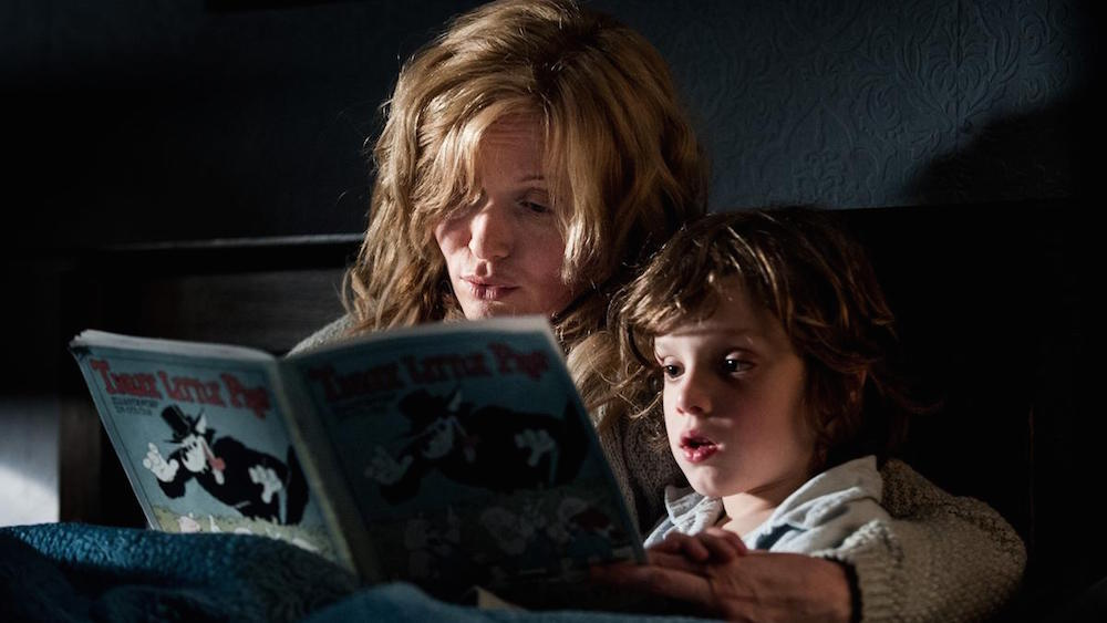 Scary kid and mom reading book