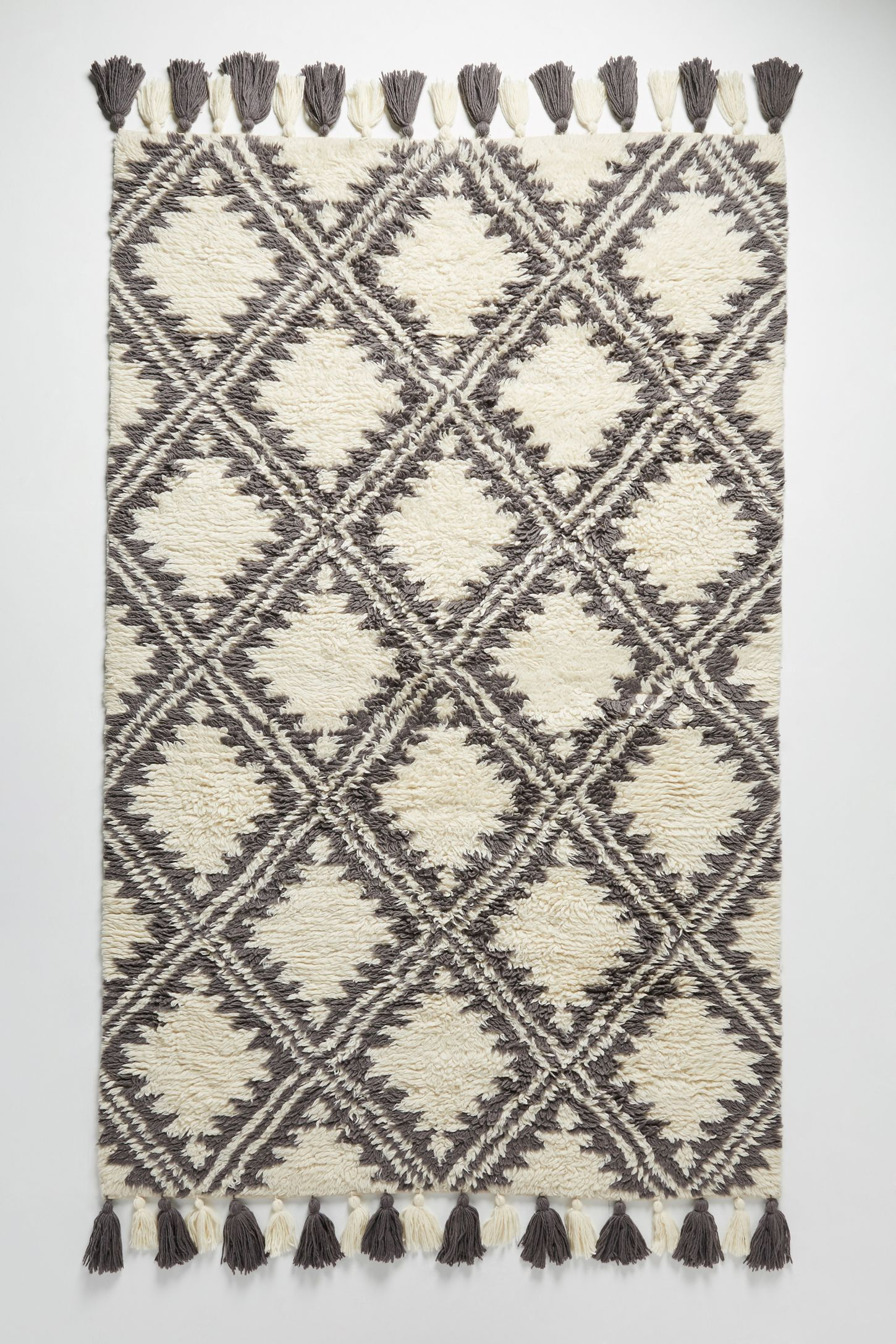 Essa Rug from anthropologie tassels on ends black and white diamond moroccan print