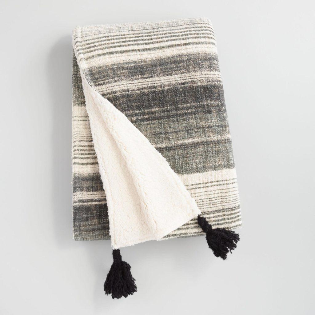 Grey and white sherpa fleece blanket from world market cost plus tassels