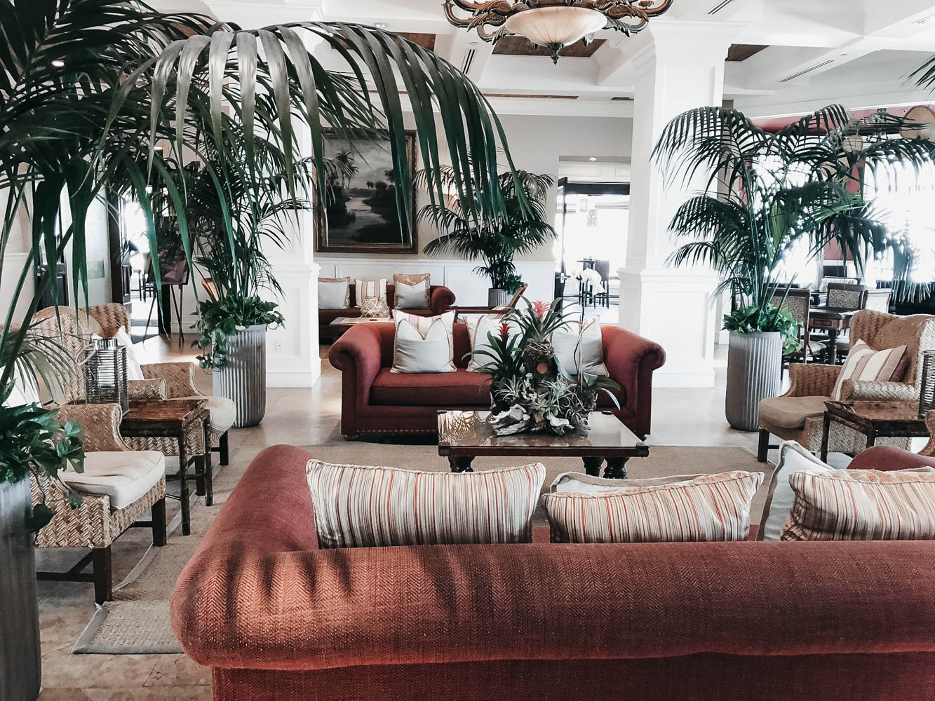 Maroon couches and palms in Florida lobby