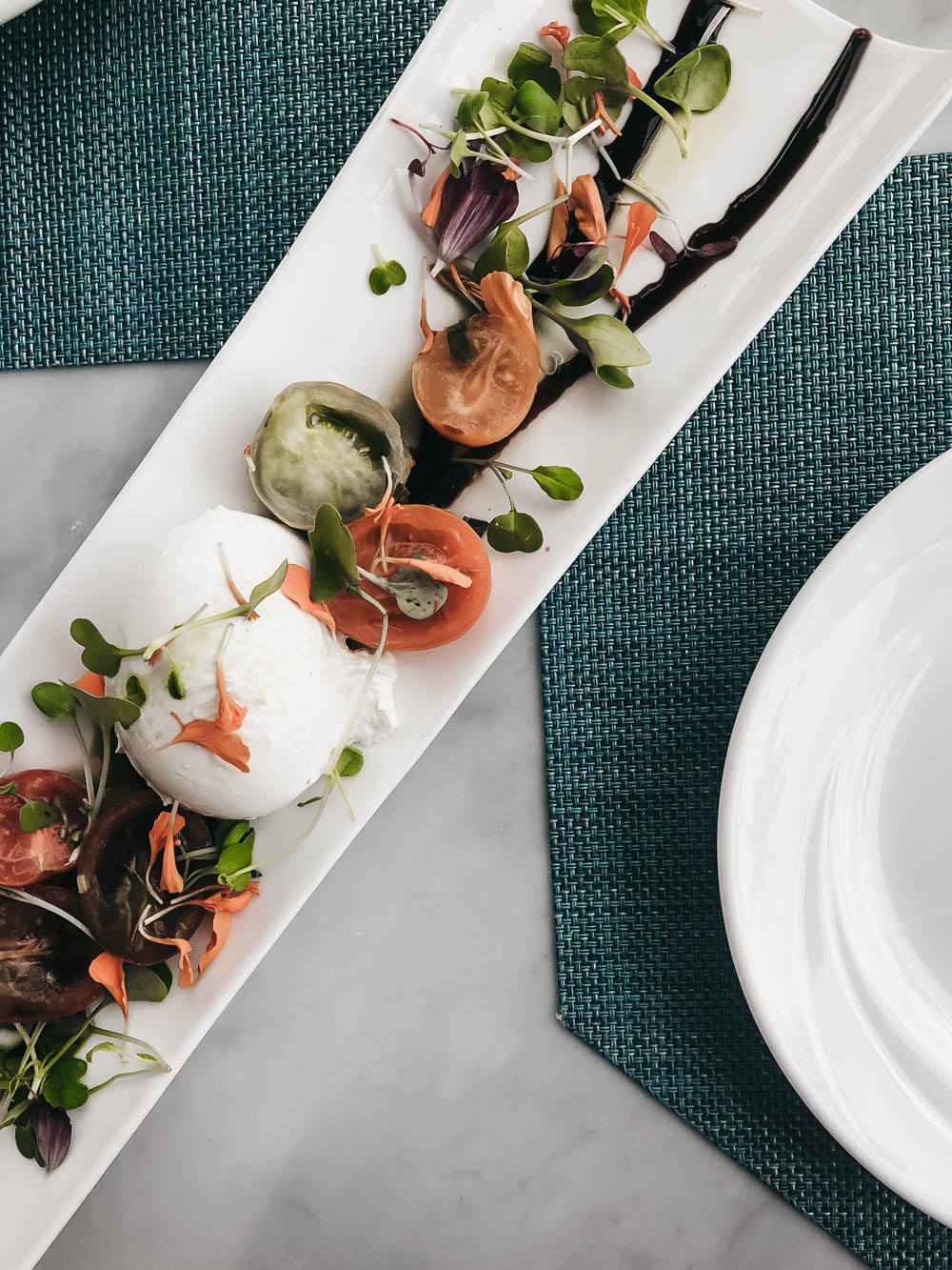 Burrata cheese with tomatoes and balsamic vinegar