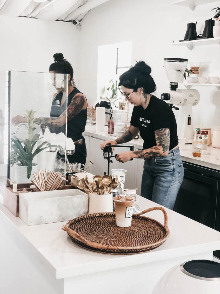 Trendy barista women making tea