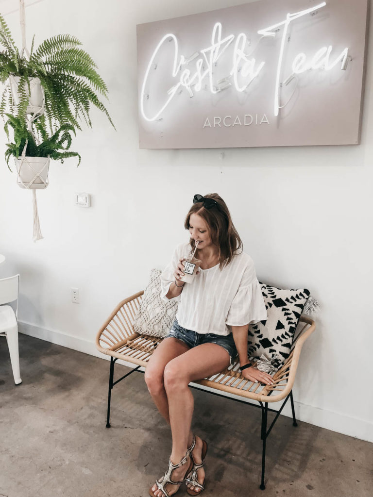 Woman sipping tea in Arcadia shop
