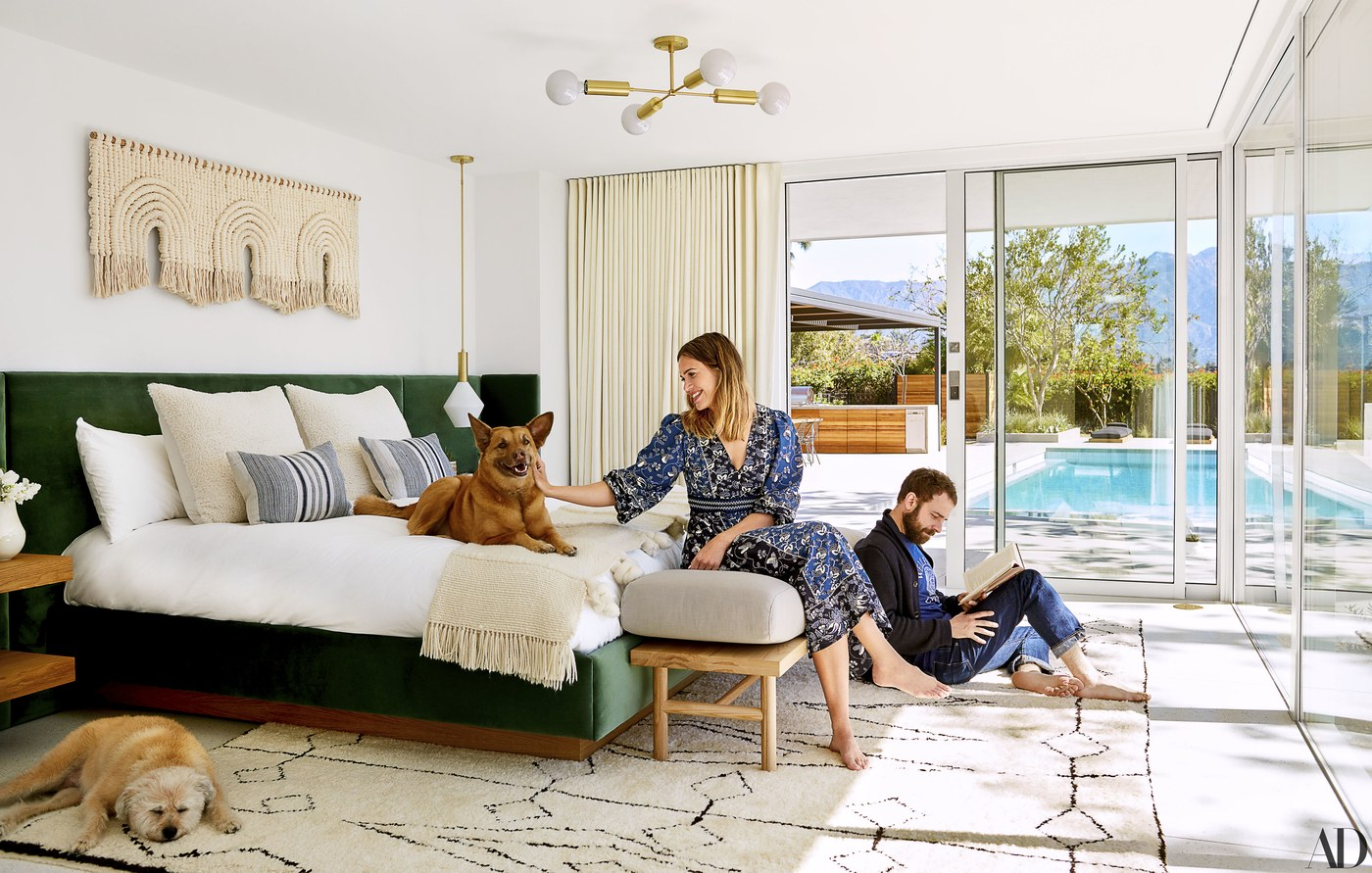 Mandy Moore & her now husband Taylor Goldsmith's master bedroom is a dream! We love her custom-built bed by  Sarah Sherman Samuel  in a  Fabricut  velvet with macramé artwork by  Sally England  above. The cozy bench by  Katy Skelton  &  Cedar & Moss  lighting just add to the beauty of the sanctuary.