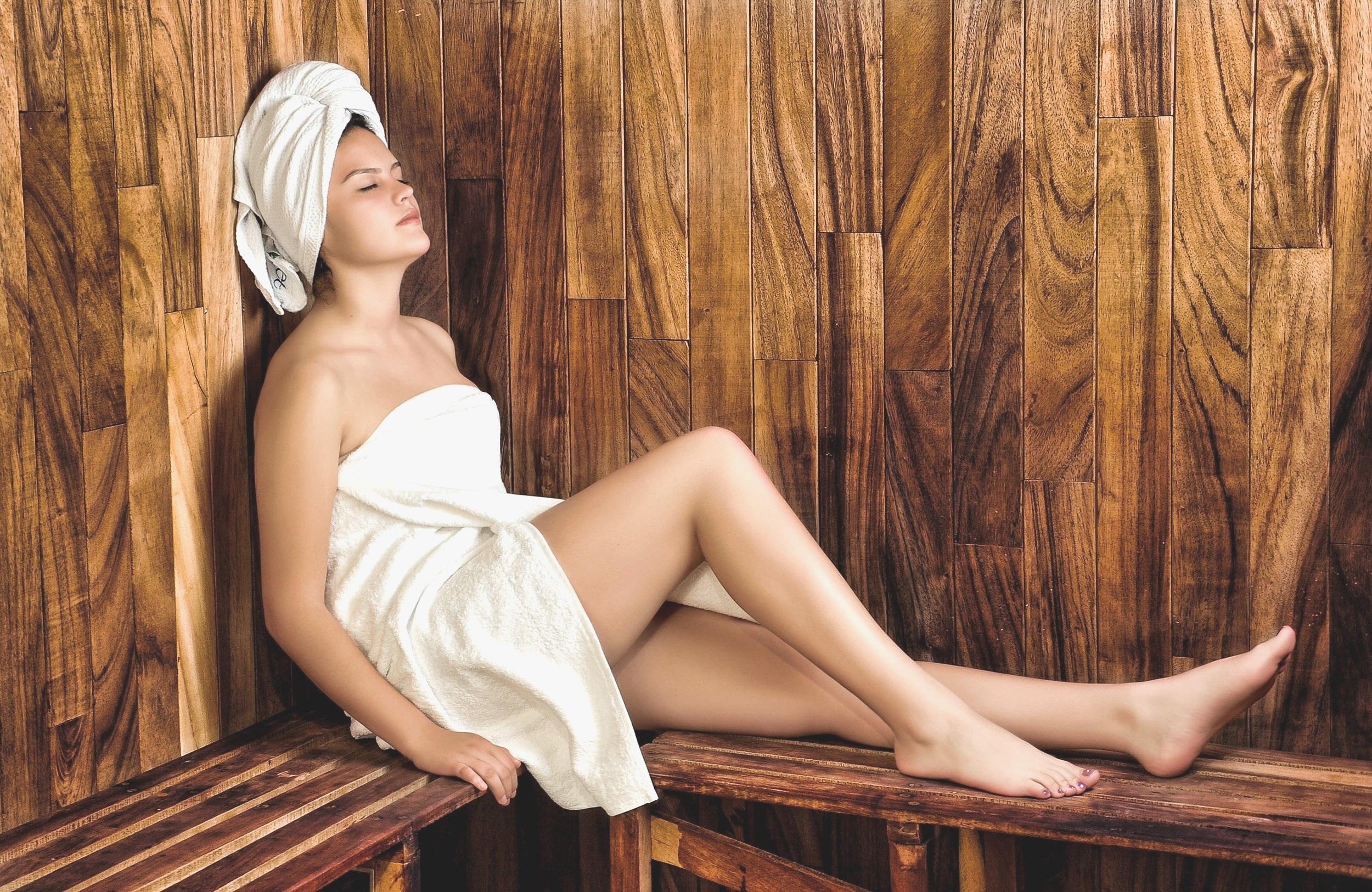 woman in towel in dry sauna room