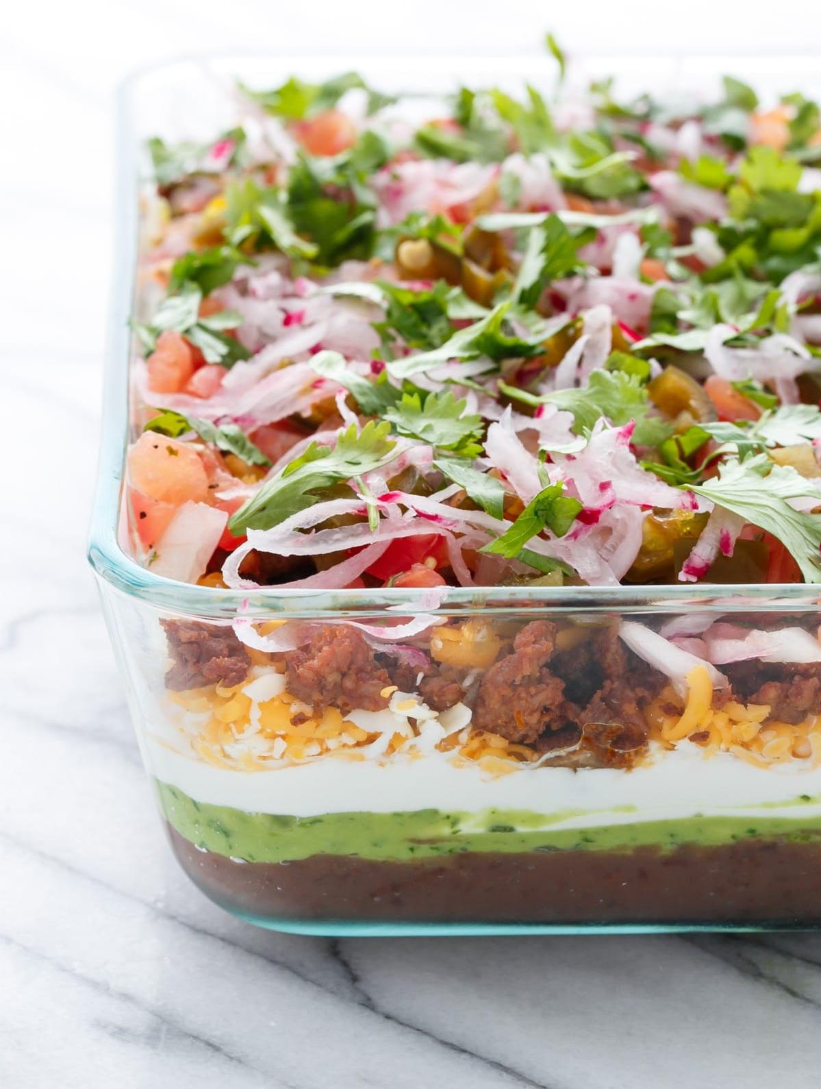 Vegetarian 7 layer dip in glass pan