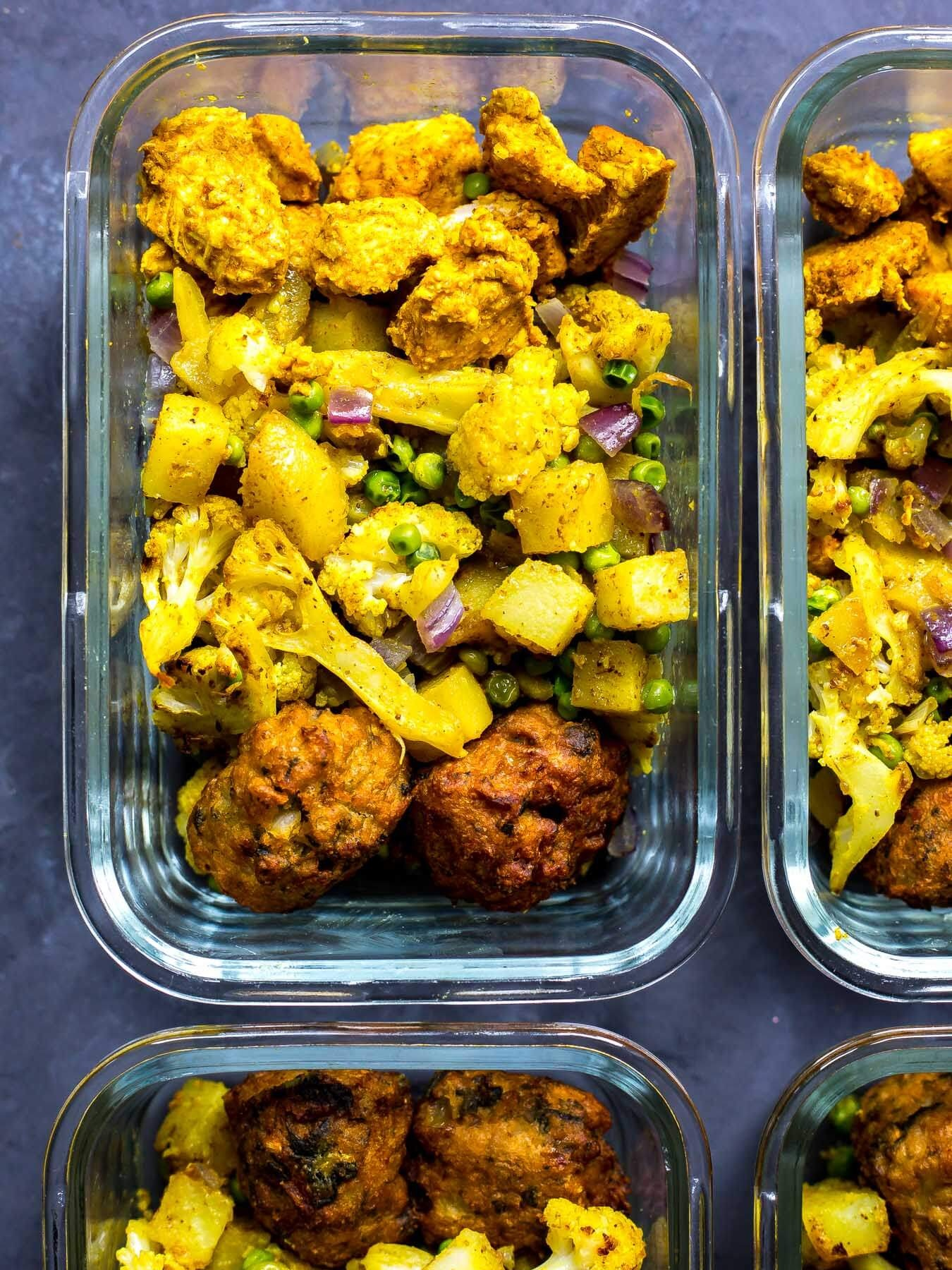 Meal prep lunch bowls with Indian tofu and aloo gobi