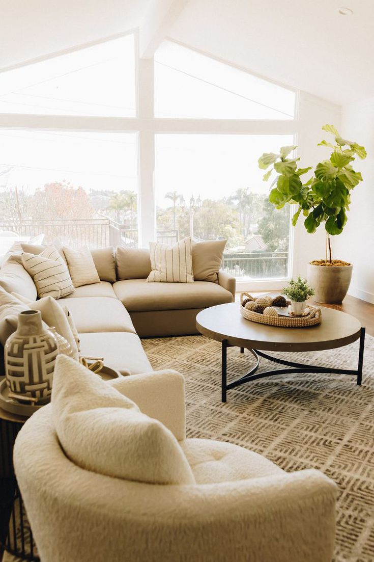 The natural light enhances the design of the neutral living room perfect for relaxing with her growing family. Photo: Karla Ticas; Design: Erick Garcia of Maison Trouvaille